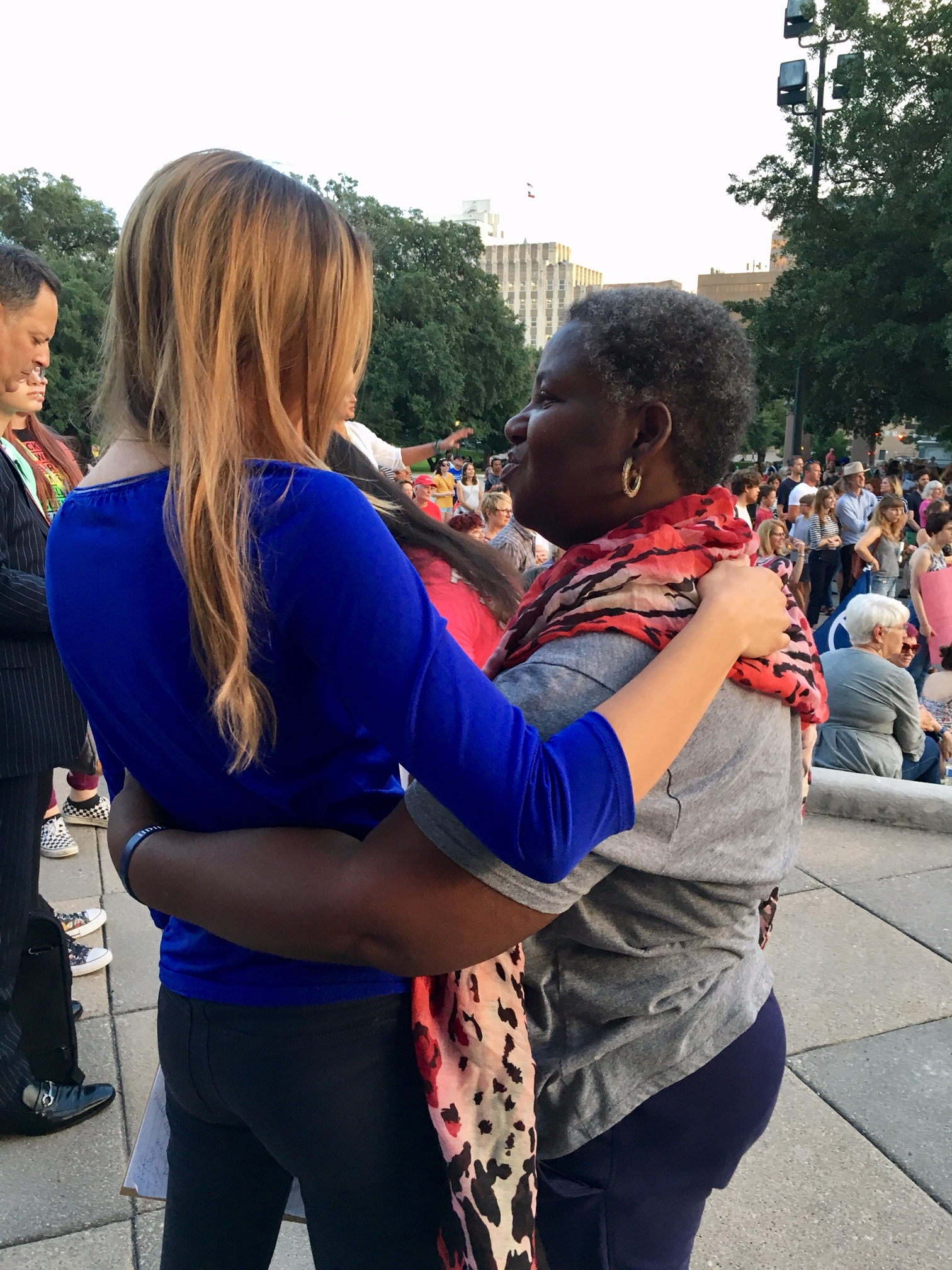 Liz meeting an attendee at the Lights for Liberty rally in Austin, TX