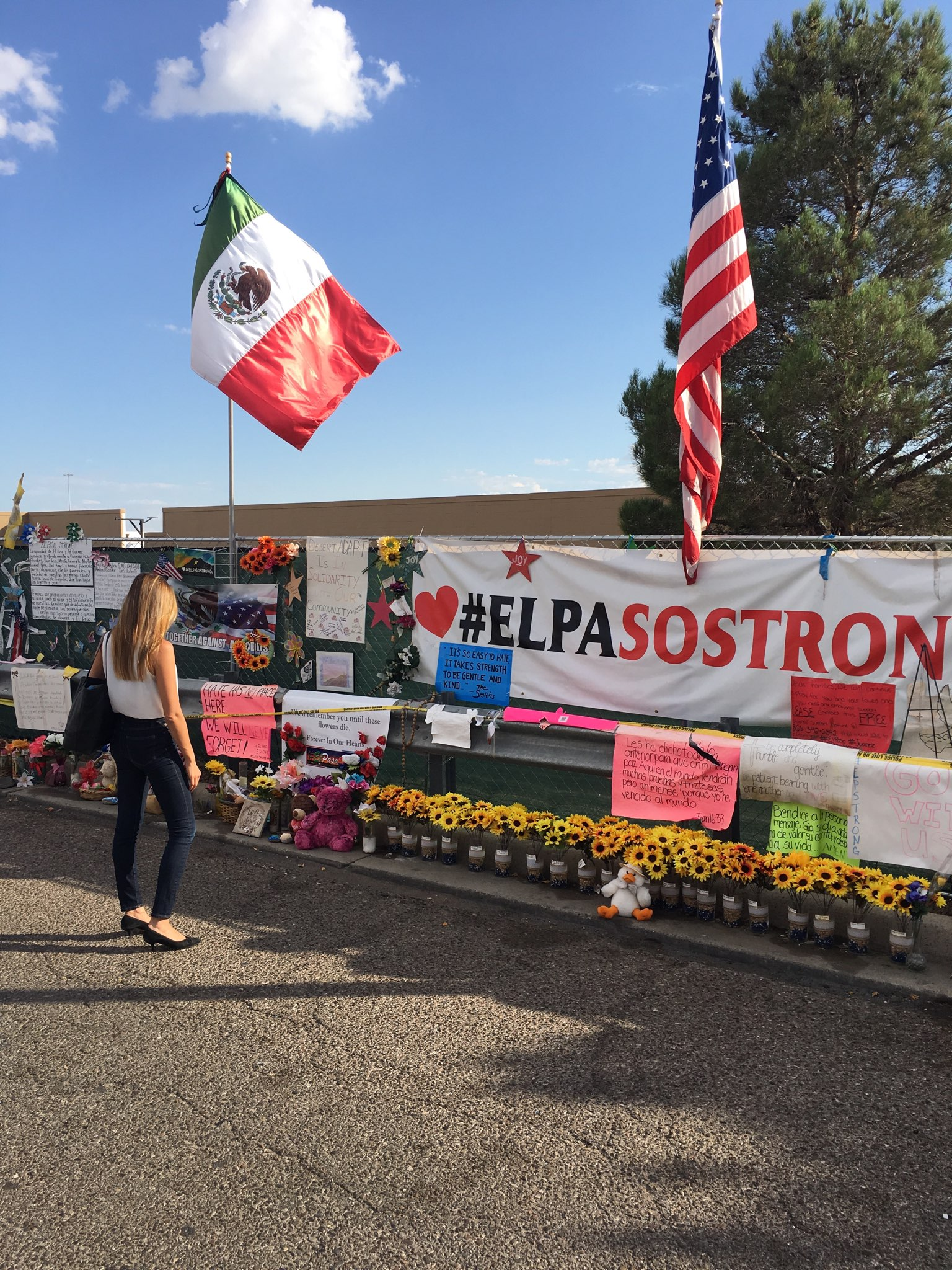 Visiting the makeshift memorial at the Walmart in El Paso where 22 innocent people died in a mass shooting