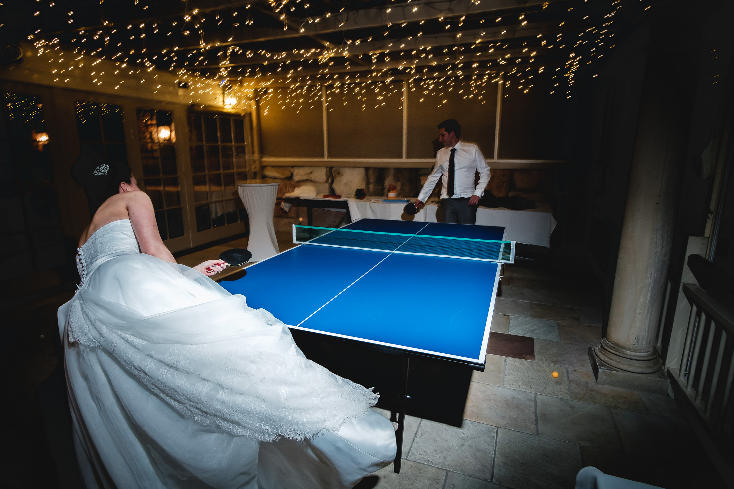 Bride and groom playing table tennis. fun, relaxed adventurous wedding photography gold coast