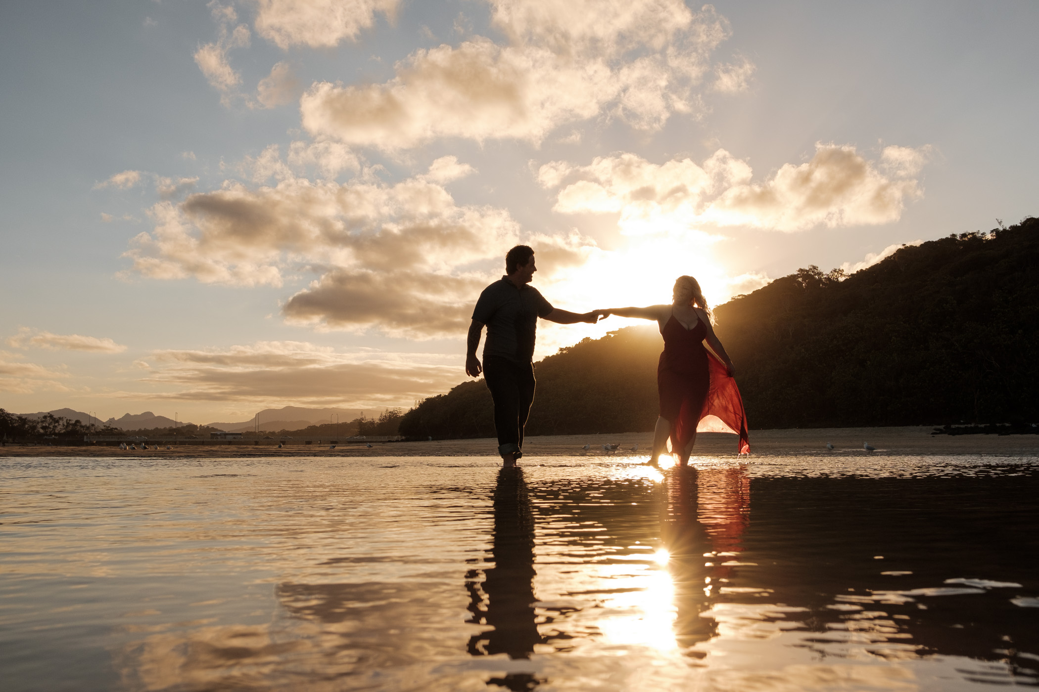 Engaged couple at sun set, burleigh Headland tallebudgera creek. Relaxed, fun, adventurous and candid engagement photography gold coast
