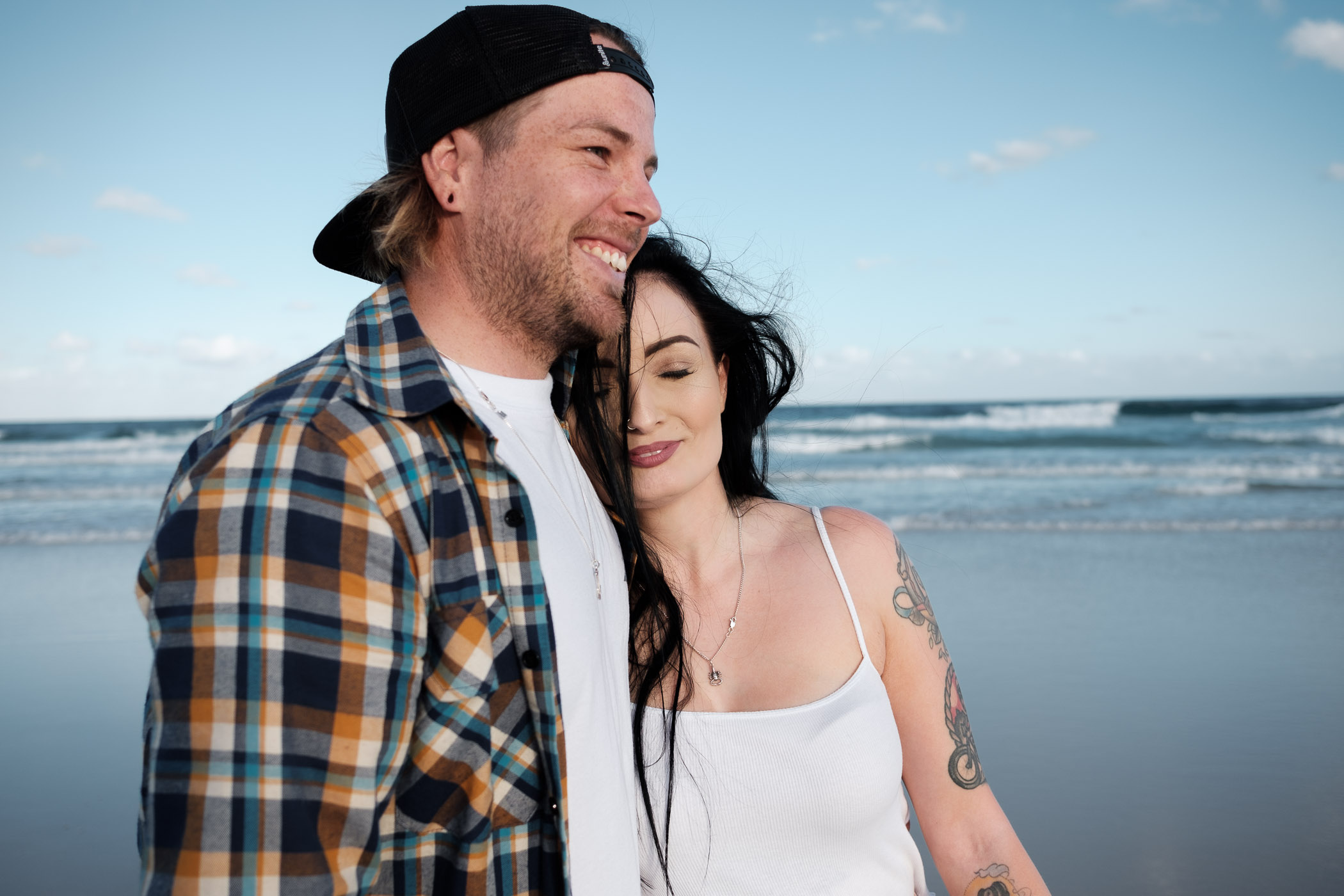 Engaged couple with Dachshund at Fingal Headland. Relaxed, fun, adventurous and candid engagement photography gold coast
