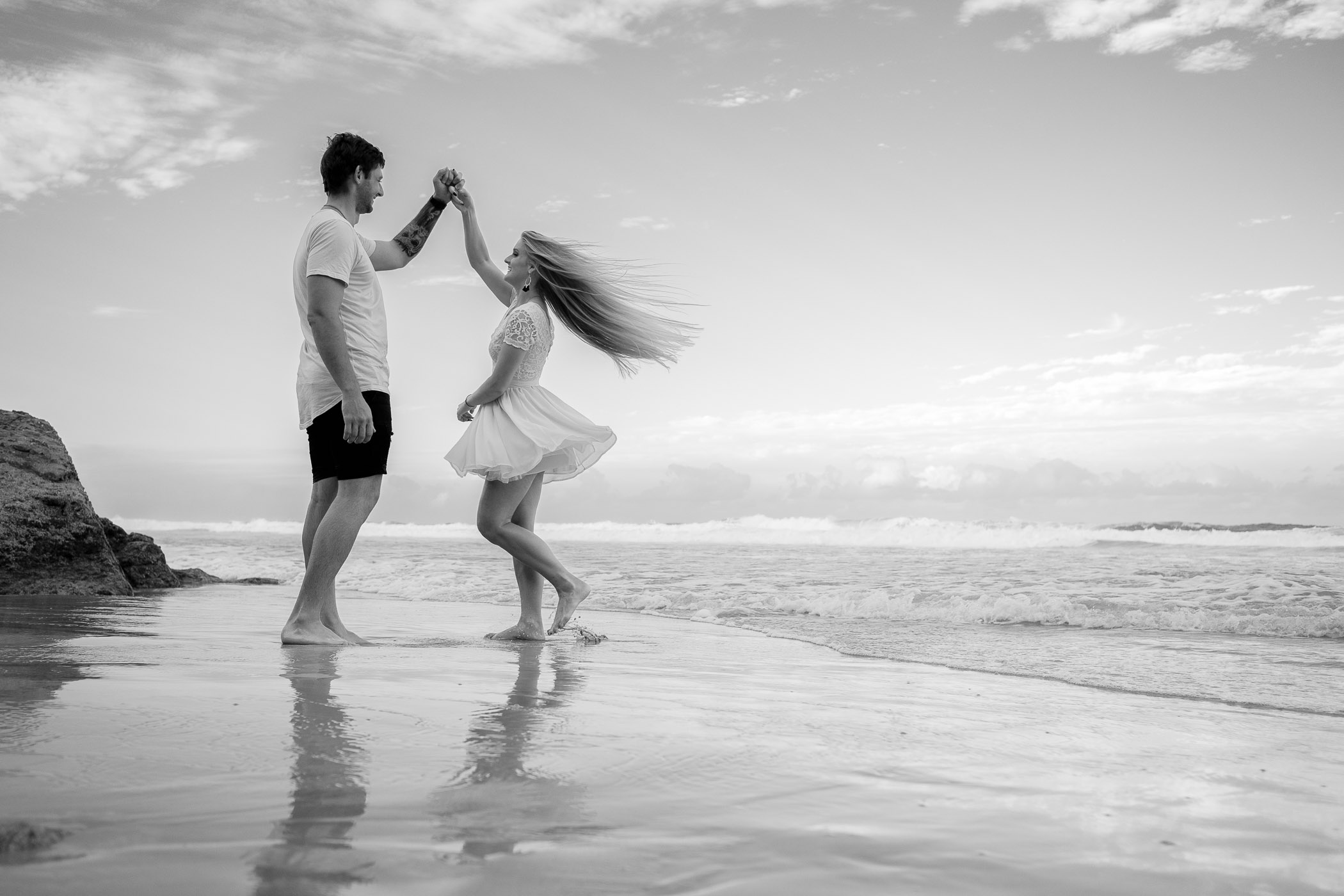 Engaged couple dancing at burleigh headland. Relaxed, fun, adventurous and candid engagement photography gold coast