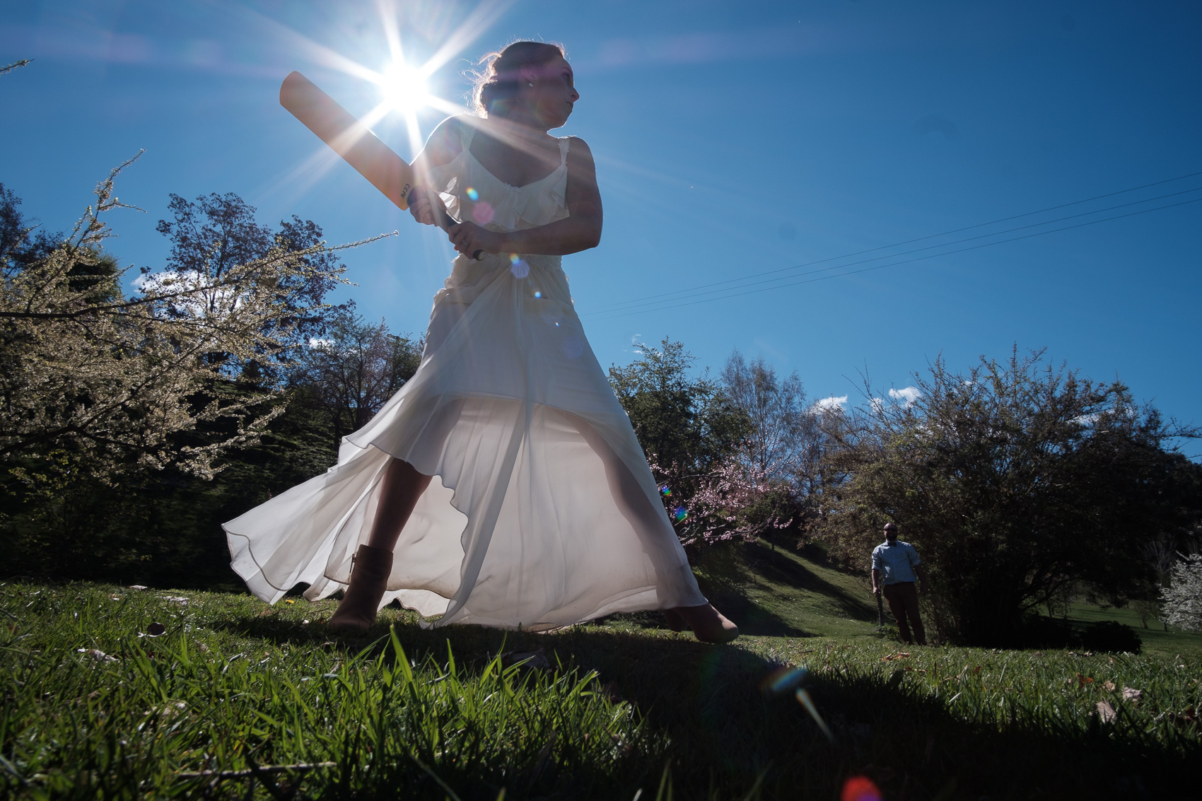 Bride playing back yard cricket.   Grandma does the hula hoop  Queenstown wedding. fun, relaxed adventurous wedding photography gold coast