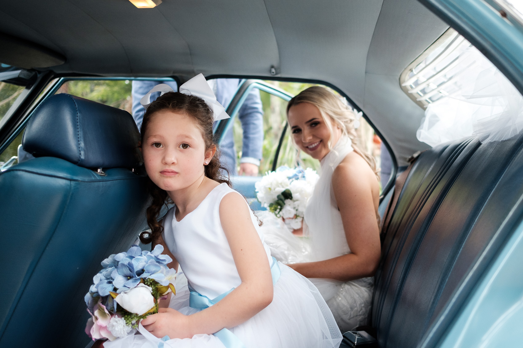 Bride and flower girl in wedding car. Braeside Chapel wedding fun, relaxed adventurous wedding photography gold coast