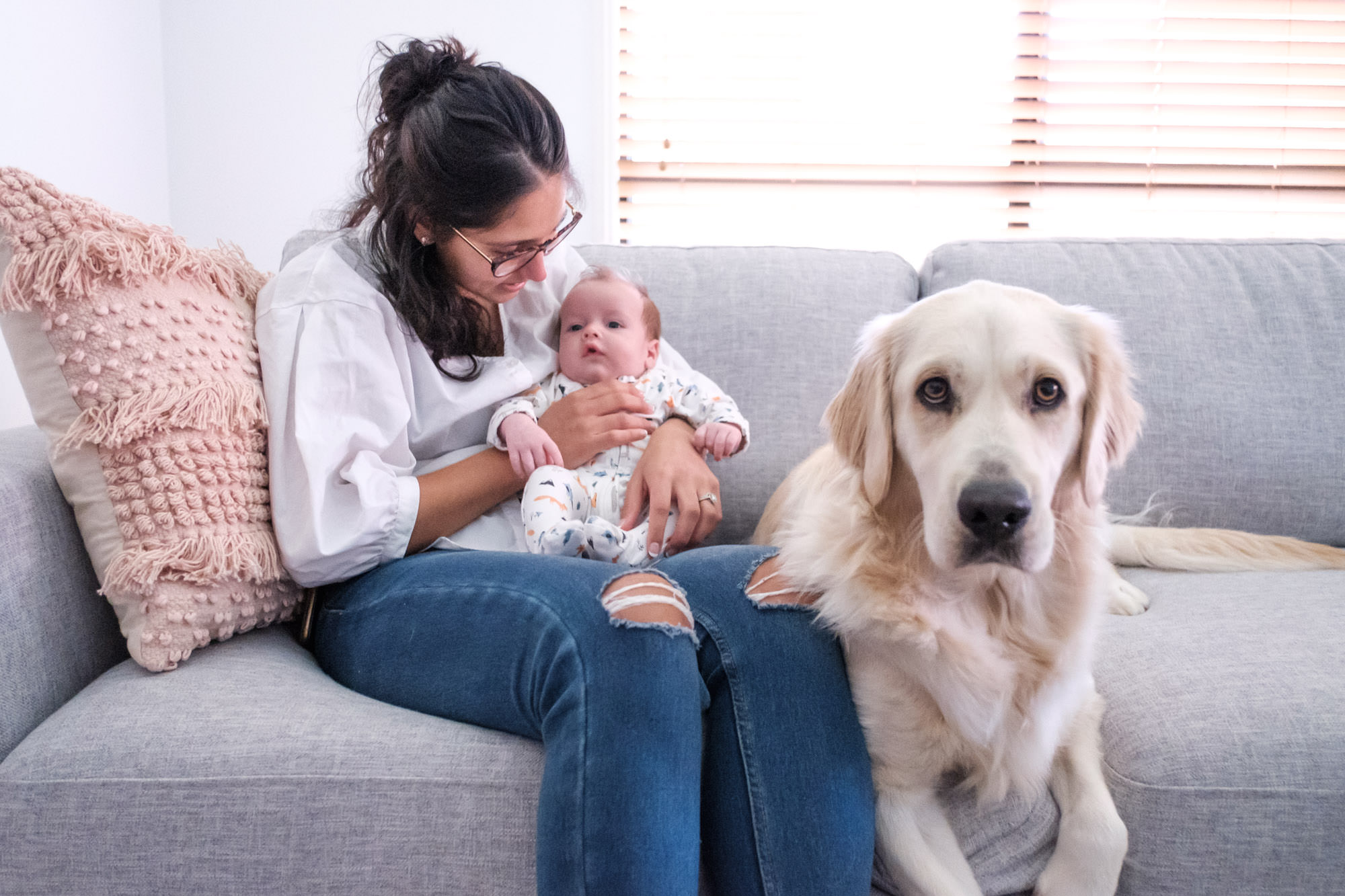 Mother and Newborn on couch in their home with golden retriever. relaxed in-home newborn photography gold coast without props