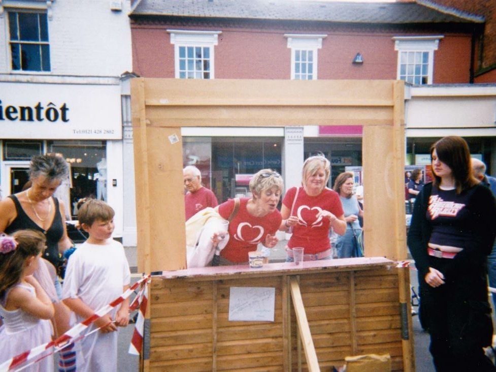 Avril and Rosanne spitting cherry stones into a bucket at one of the first Harborne Carnivals (wearing St John's red T-shirts). 2003/4