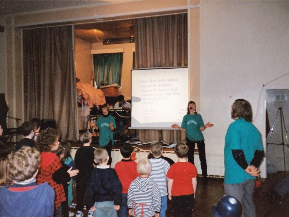 """Avril leading a monthly Saturday Children's Club called """"It's Saturday!"""". 'We wore green T-shirts stating """"It's Saturday!"""".' This was taken in 1998/9"""