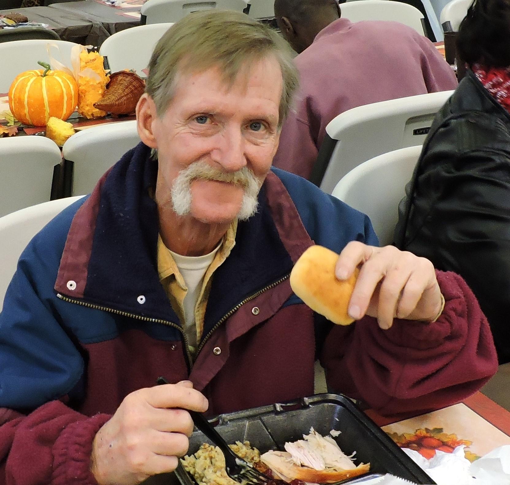 Man eating at Thansgiving.jpg