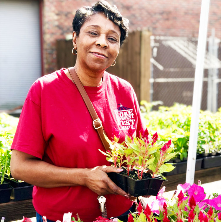 minority-woman-purchasing-flowers.jpg