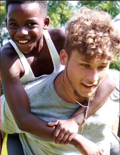 Camp-JOY-boys-carrying.jpg