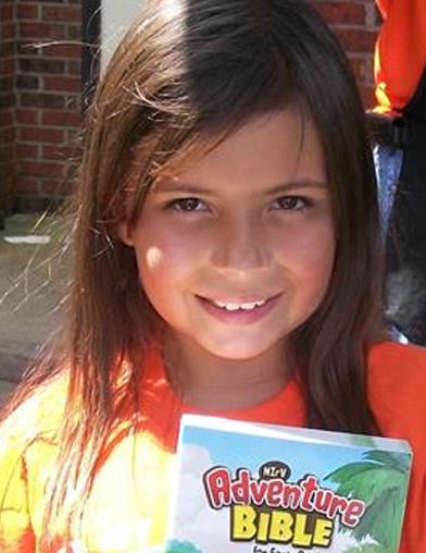 Camp-JOY-girl-with-bible.jpg