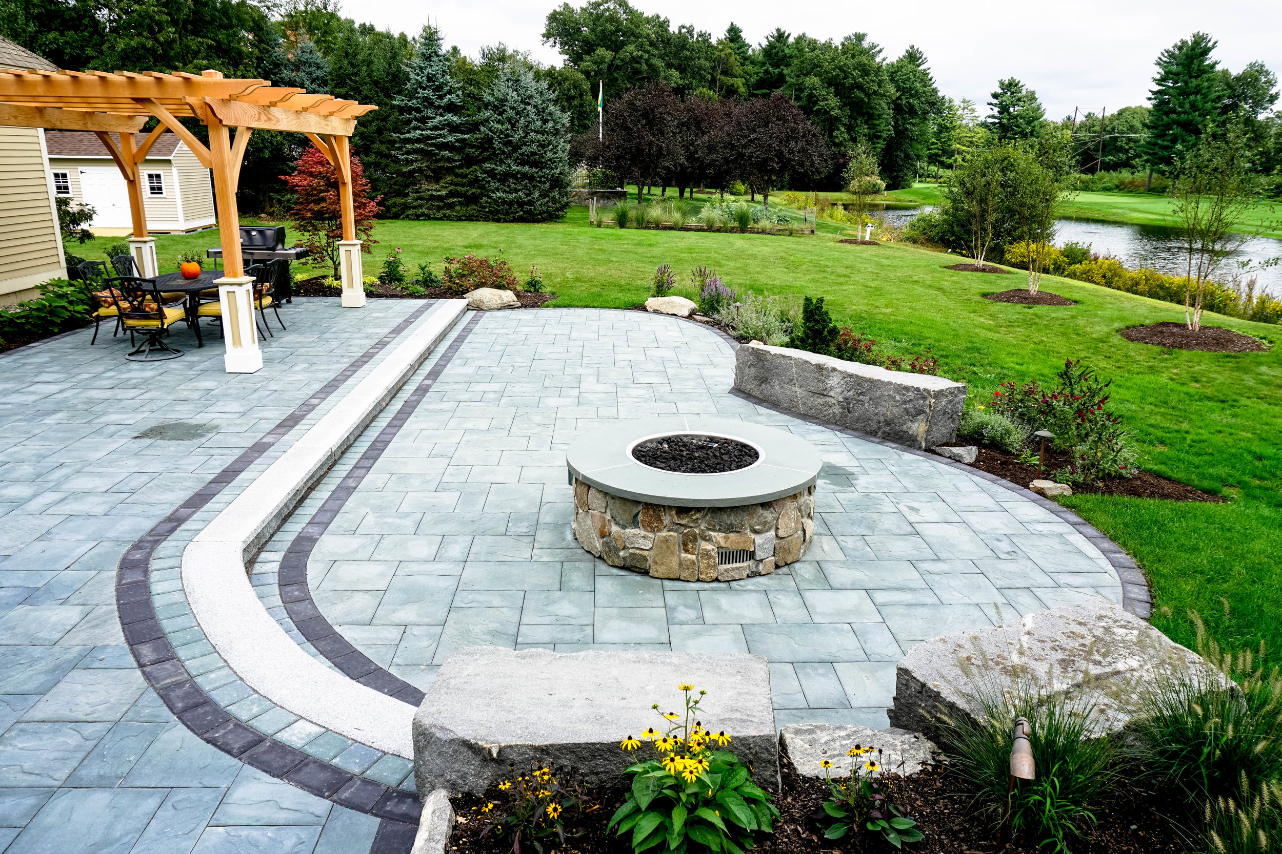 Windsor Green - Full landscape design, new plantings, lawn installation, irrigation improvement, landscape lighting, hot tub install, pergola, deck, and more. Front yard and driveway improvements coming soon!