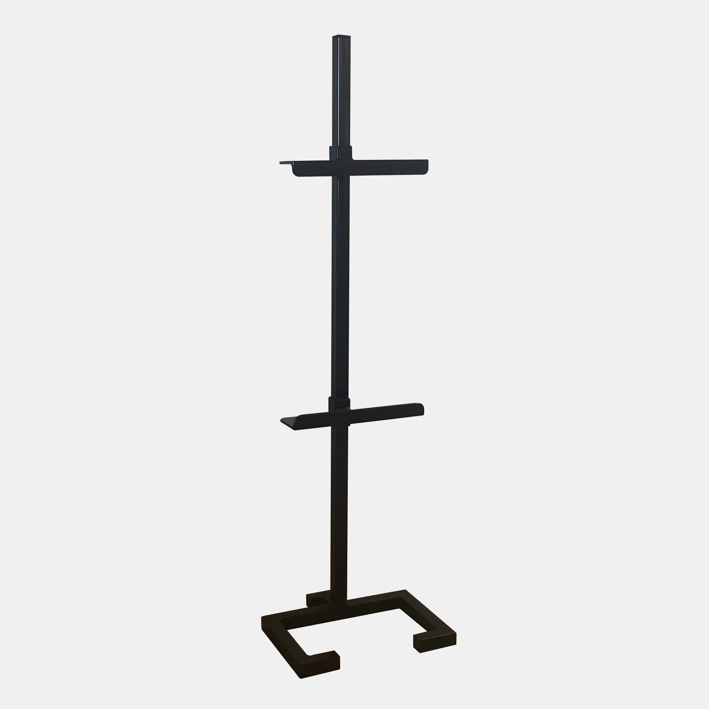"Small Steel Easel  Black powder-coated steel base with hollow-core post and adjustable brackets. Custom made in Atlanta, GA. Small: 42"" high (for tabletop use), 12""x10.5"" base. All brackets 2.5"" deep. Additional brackets available for use with two pieces of art. SKU449FMW"