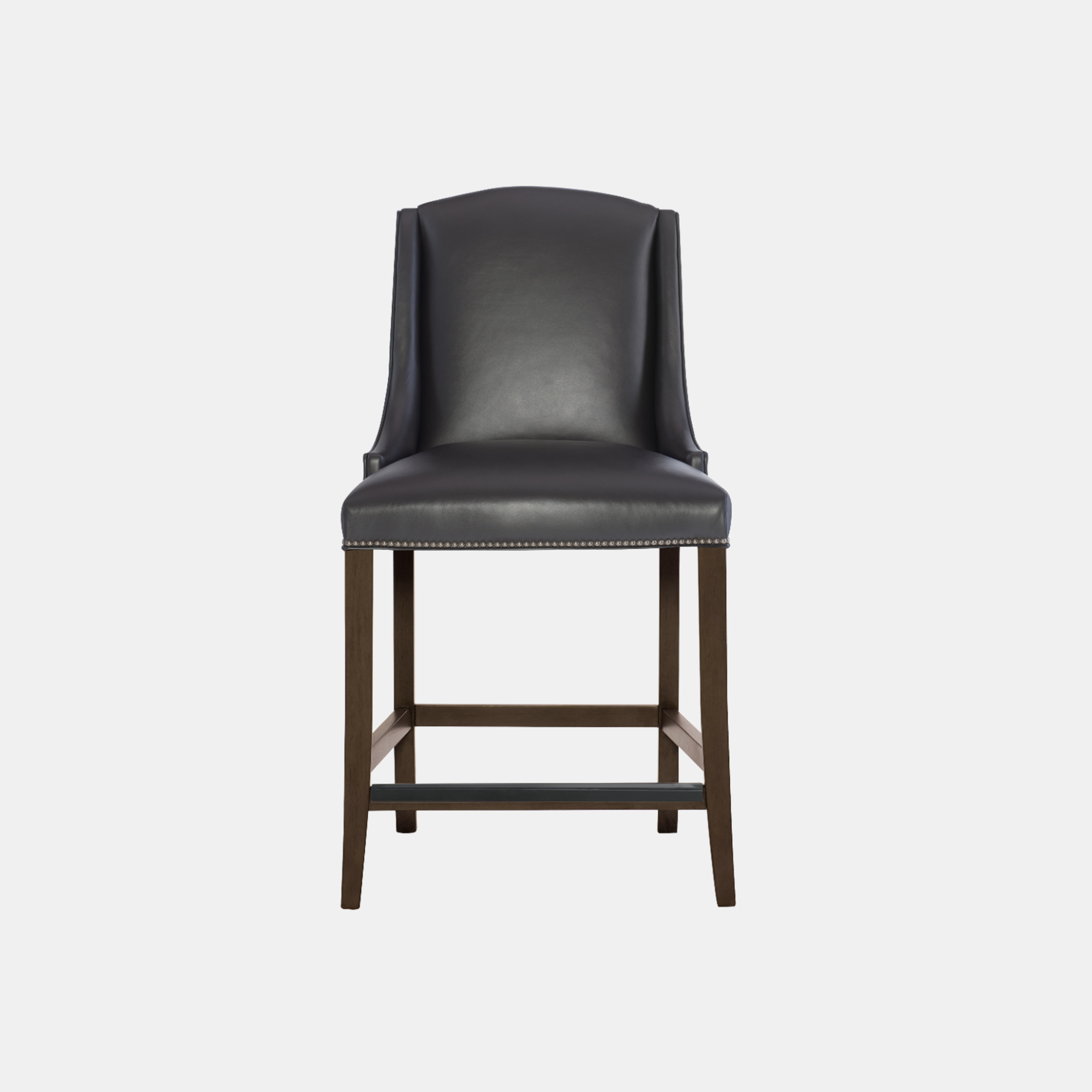 "Slope Bar Stool  24.5""w x 26""d x 47-3/8""h Available in fabric and leather. Wood finish available in cocoa (shown), smoke, or chalk. Also available as counter stool and dining chair. SKU5930BHT"