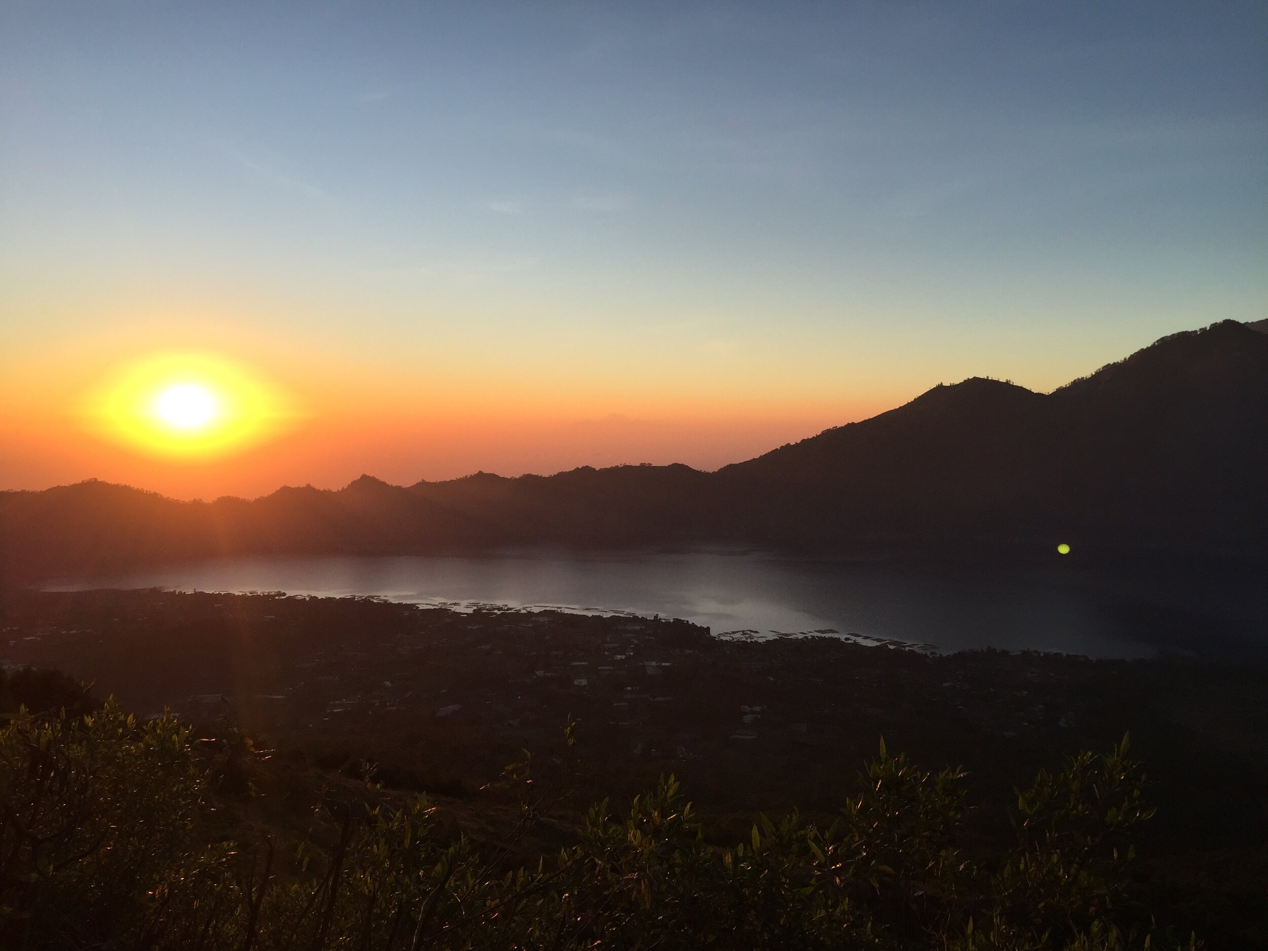 Watching the sun rise over the valley from Mount Batur in Bali