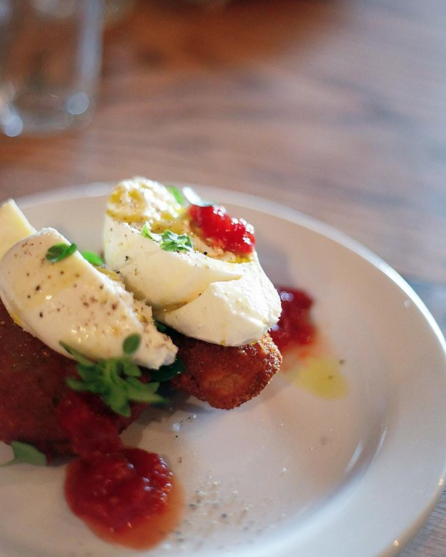 We have a new spin on our burrata! Now with fried eggplant, tomato jam and basil.