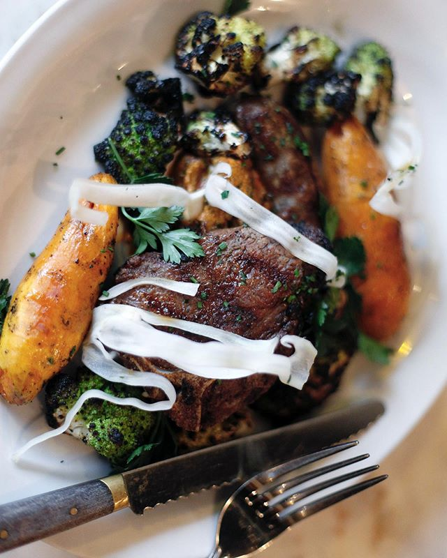 A new fall favorite, our lamb mix grill - porterhouse and sausage with romanesco, duck fat sweet potatoes and hazelnut romesco.