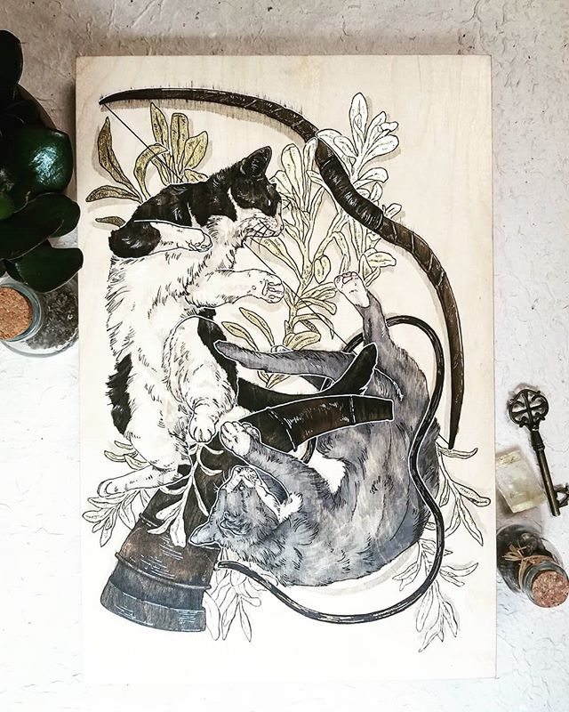 "It was my friend's birthday recently and I love her very much so I made her a piece featuring her cats whomst I love very much as well 🐱 . Created on a 12""x18"" wooden canvas with inks, acrylic paint and gold leaf . I'm falling in love with working on wood 😍 . . . #traditionalart #cats #traditional #artistsoninstagram #art #catart #gold #goldleaf #ink #pen #color #paint #painting"