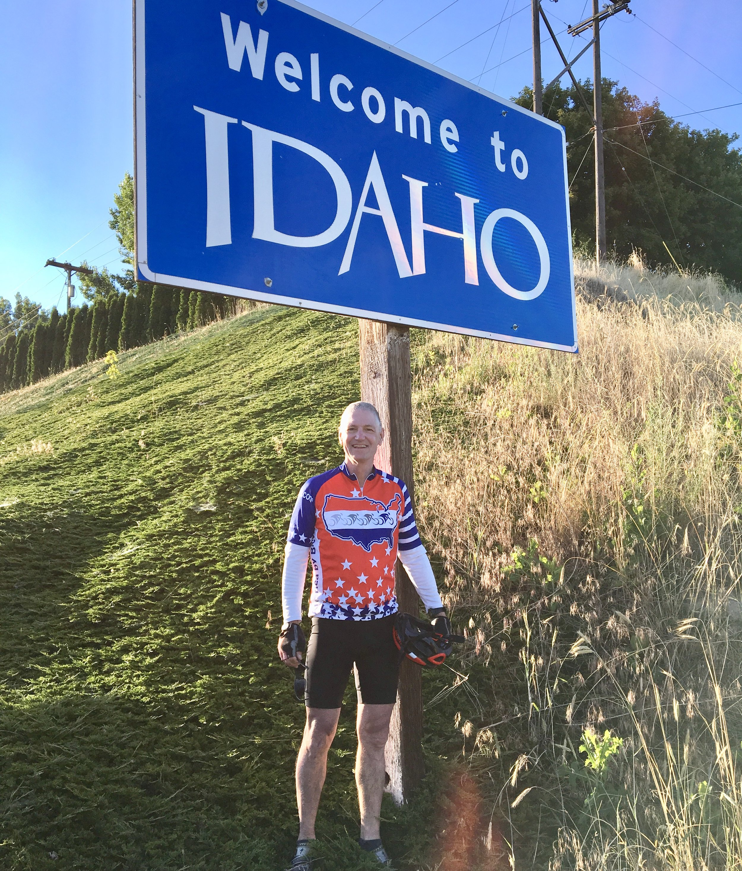 "- Cars tooted their horns at us encouragingly as we posed at the ""Welcome to Idaho"" sign at the bridge over the Snake River."