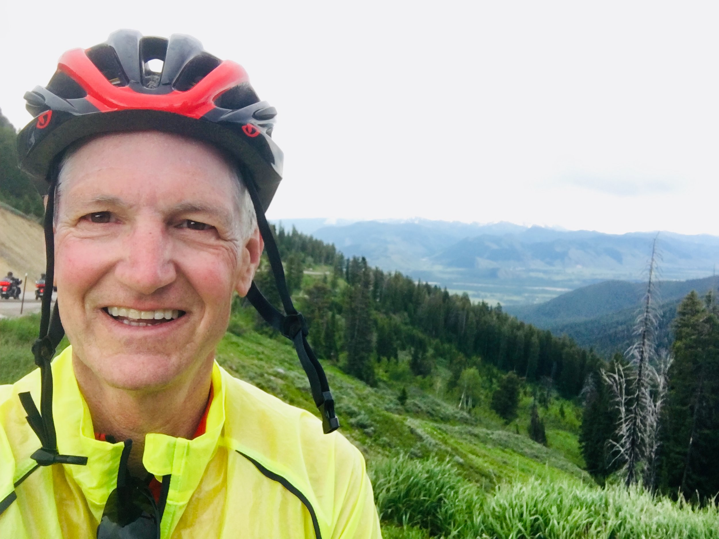 - Selfie from the top of Teton Pass overlooking Jackson, with mountains in the distance.