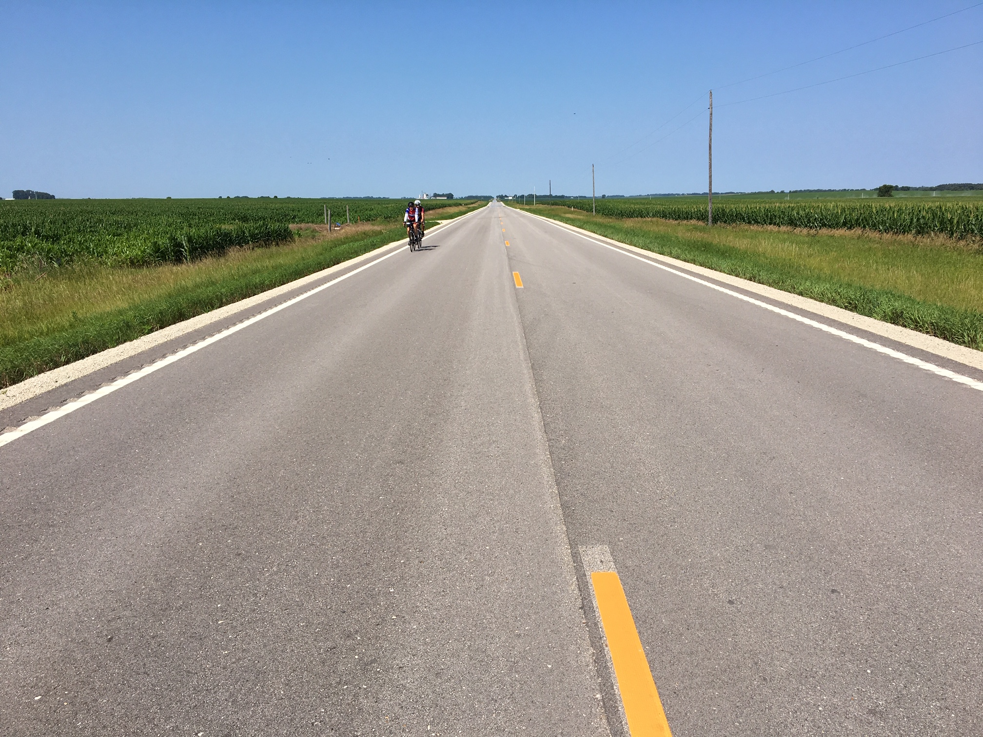 - The roads today were mainly flat and lined on both sides with corn or soybeans. The road shown here is not a ga-dunk road.