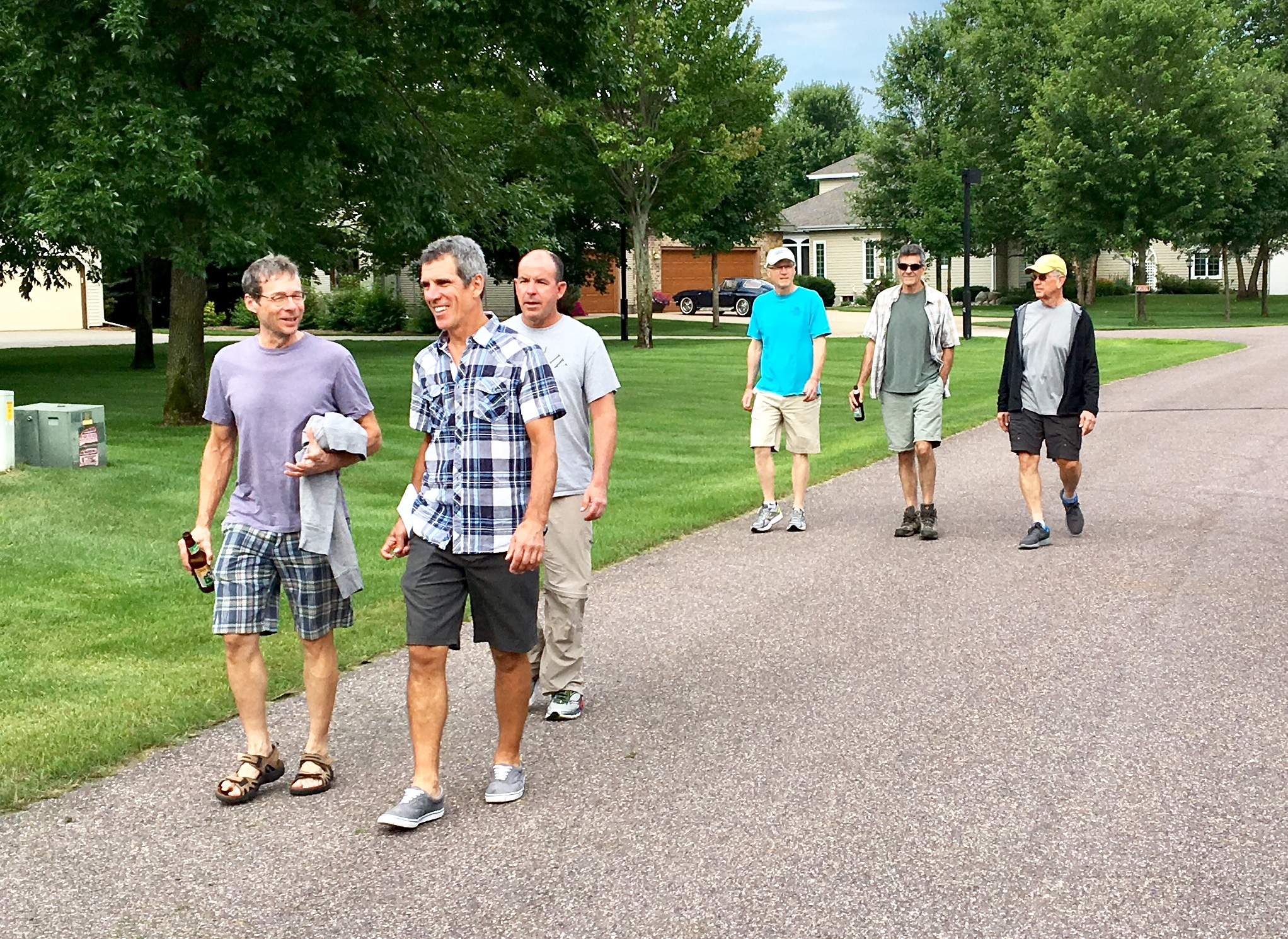 - Walking to dinner at Jim's (second from left) summer home on Castle Rock Lake. I'm not shown, as I took the photo.