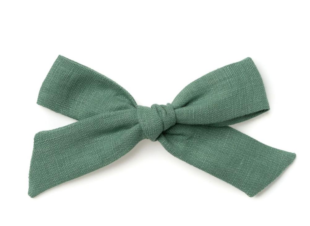 Bow - Love how these muted green bows pop against Neva's auburn hair.