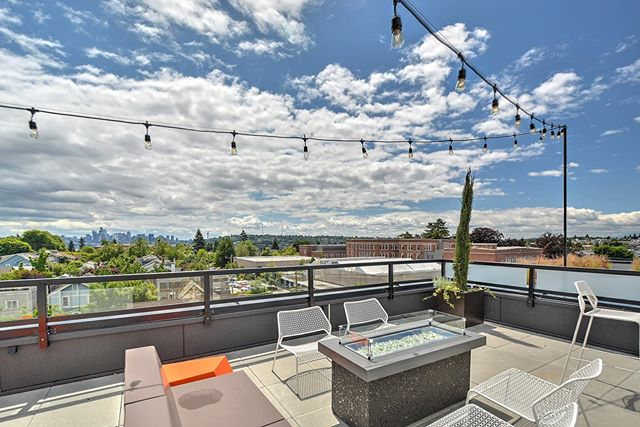Our roof deck at Wallingford 45 has a gas fireplace, 2 BBQ's and tons of outdoor seating for weekend guests! Come check out the summer sunsets with our 21 residents that now call Wallingford 45 home! . . . #wallingfordseattle #wallingford45 #condos #condo #selling #sold