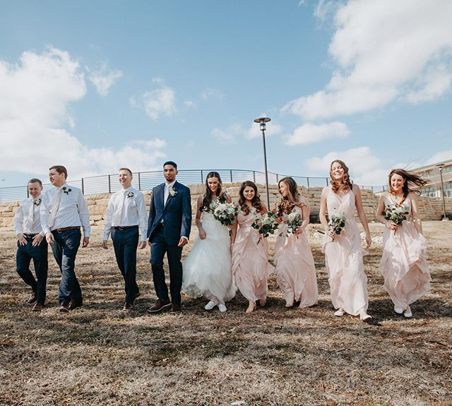 Don't know what it is about the bridal party walk, but I loved the candidness of this shot every time!  #photography #weddingphotos #weddingphotography #wichitaweddings #wichitaweddingphotography #weddingvideo #ilovewichita #kansasbrides #brides #weddings #ido #thekansasbride #wichitabride #wichitabridalexpo @kait.ambrose @cedrick22