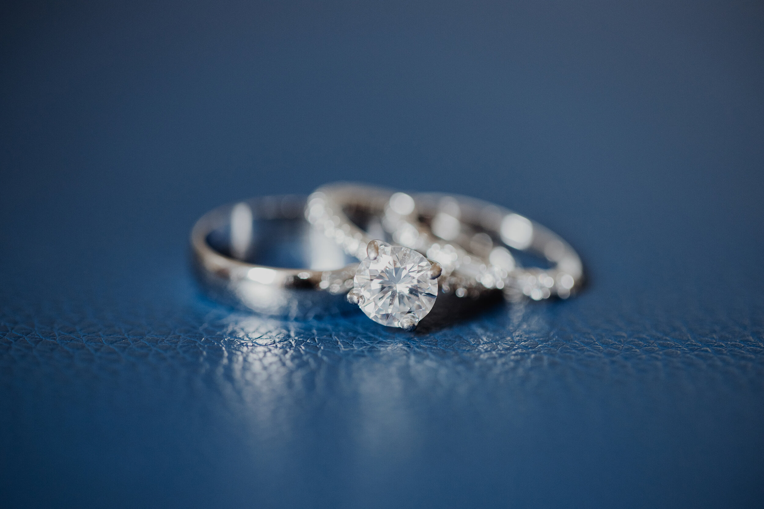 Nate and Nicole's beautiful wedding rings with her sparkling engagement ring
