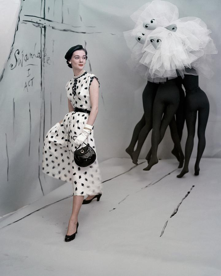 Mollie Parnis, one of the subjects of  The Hidden History of American Fashion , designed this grape-printed dress, which appeared in U.S. Vogue, May 1, 1953.