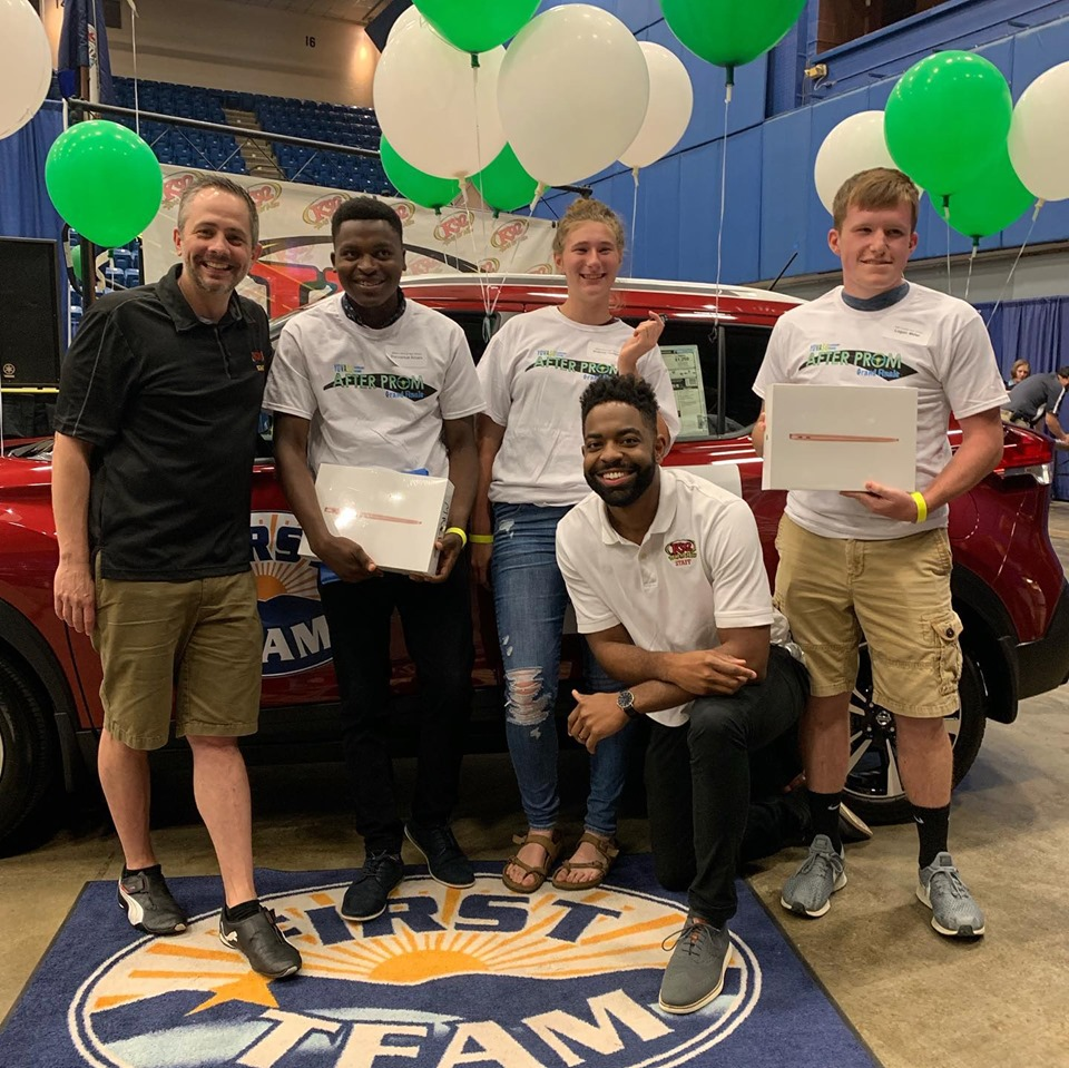 Bienvenue Amani from William Fleming High School in Roanoke and Logan Miller from Bath County High School in Hot Springs won MacBook Air laptops.
