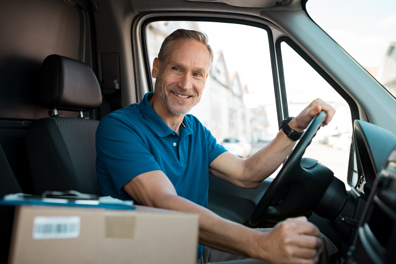 bigstock-Delivery-man-driving-van-with--221146801.jpg