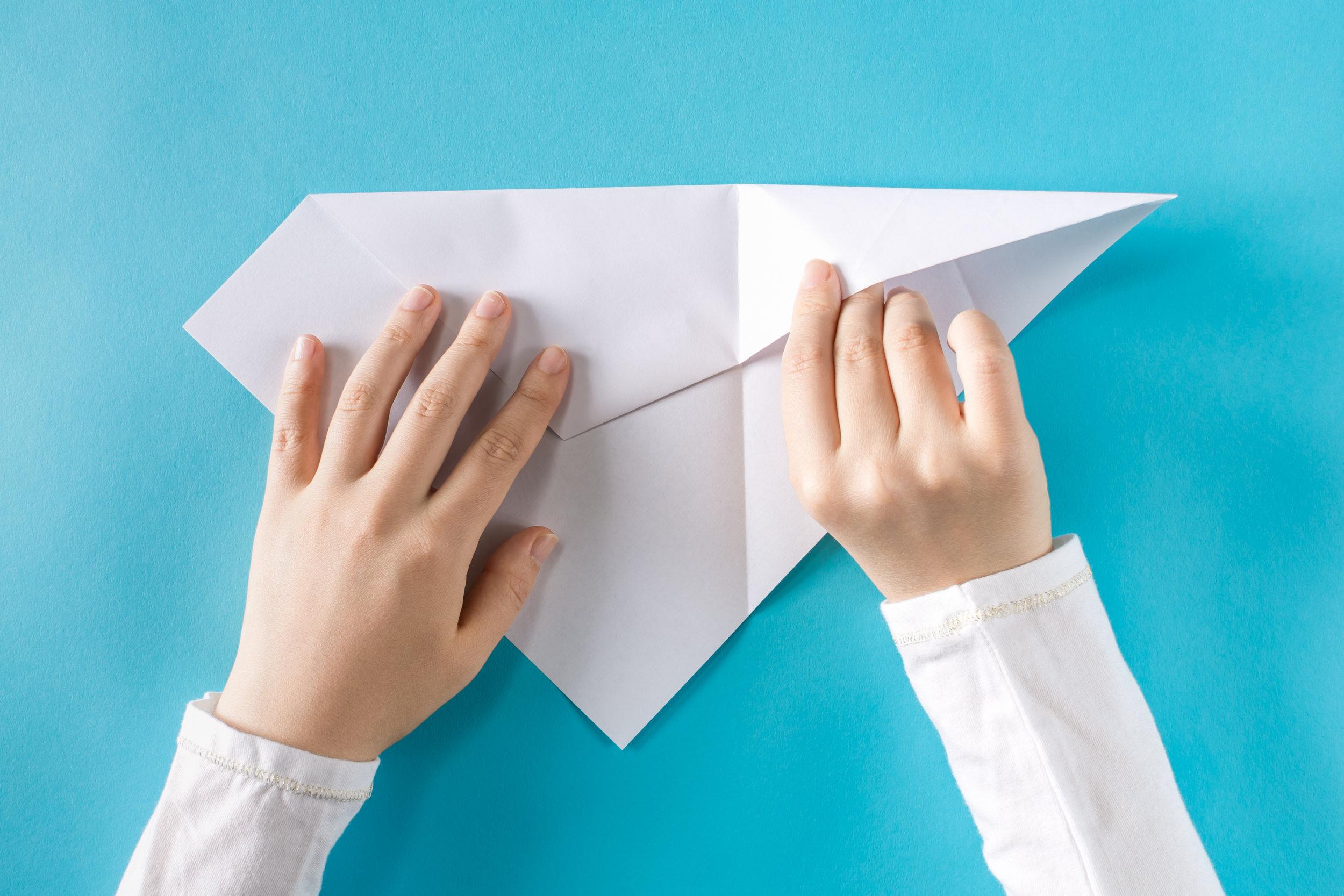 paper plane folding.jpeg