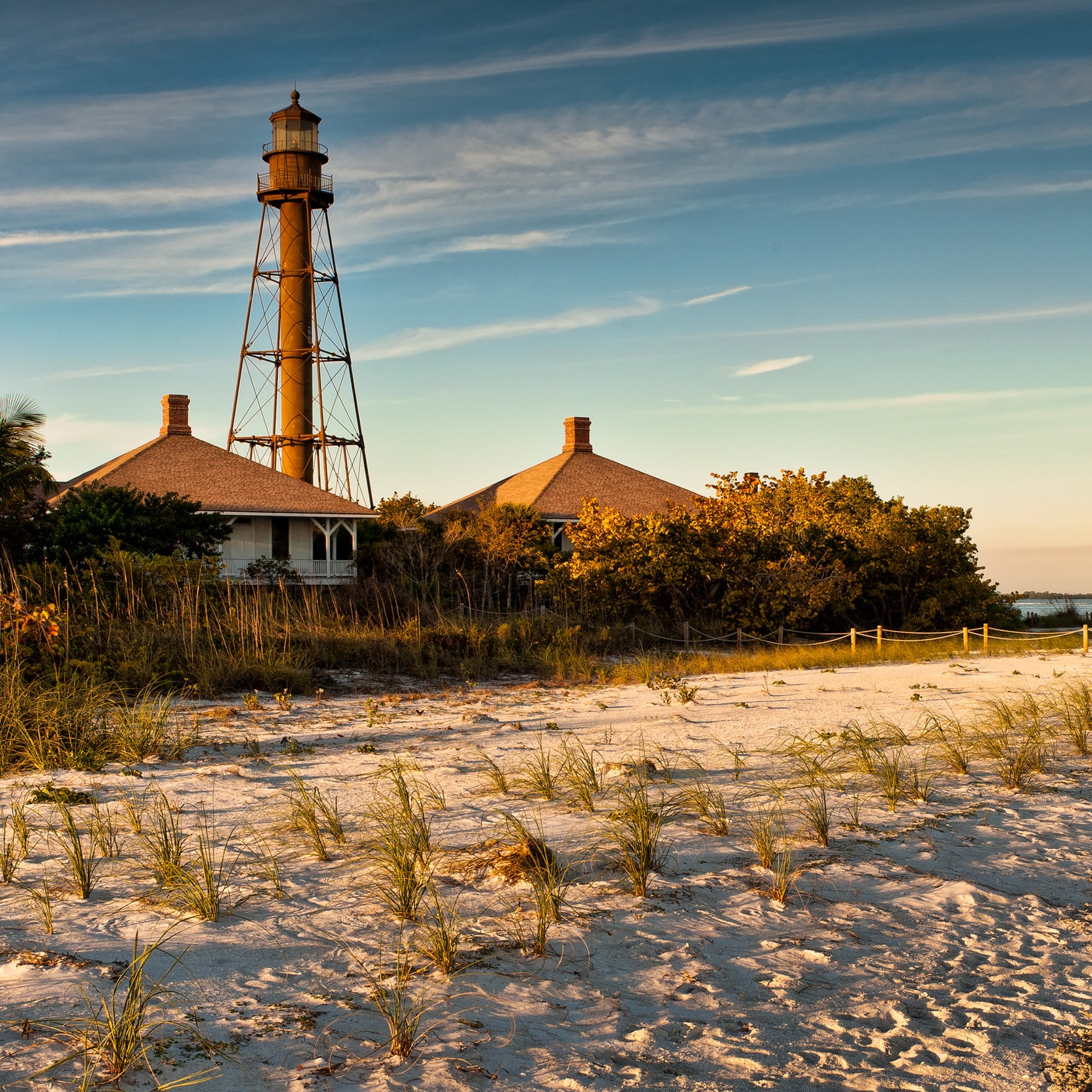 Lighthouse and Pristine Florida Beach at Sunset