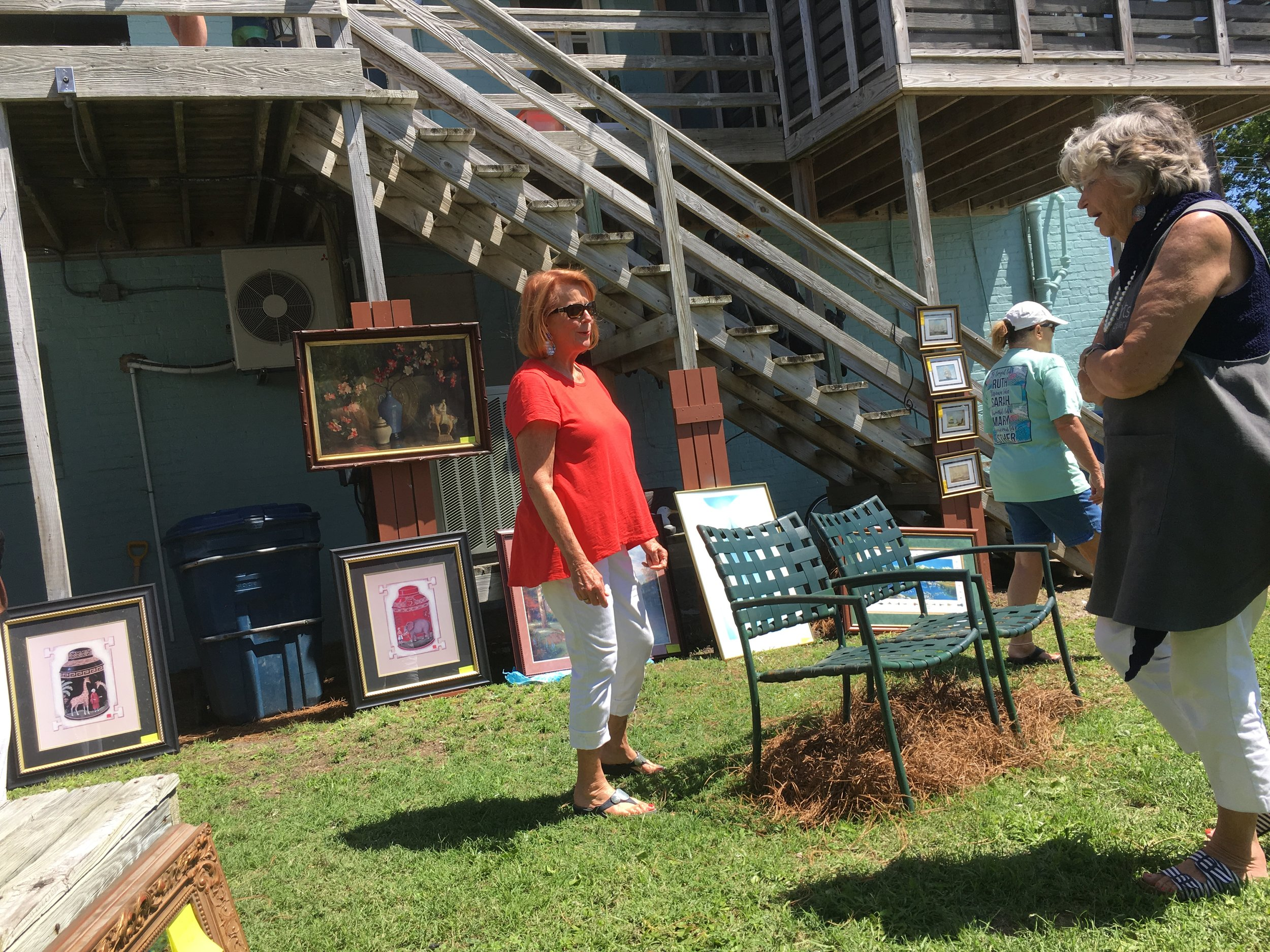 Father's Day Upcycle Event  Saturday, July 15, 2019  Sandy (belle) talking to some of the courtyard visitors!