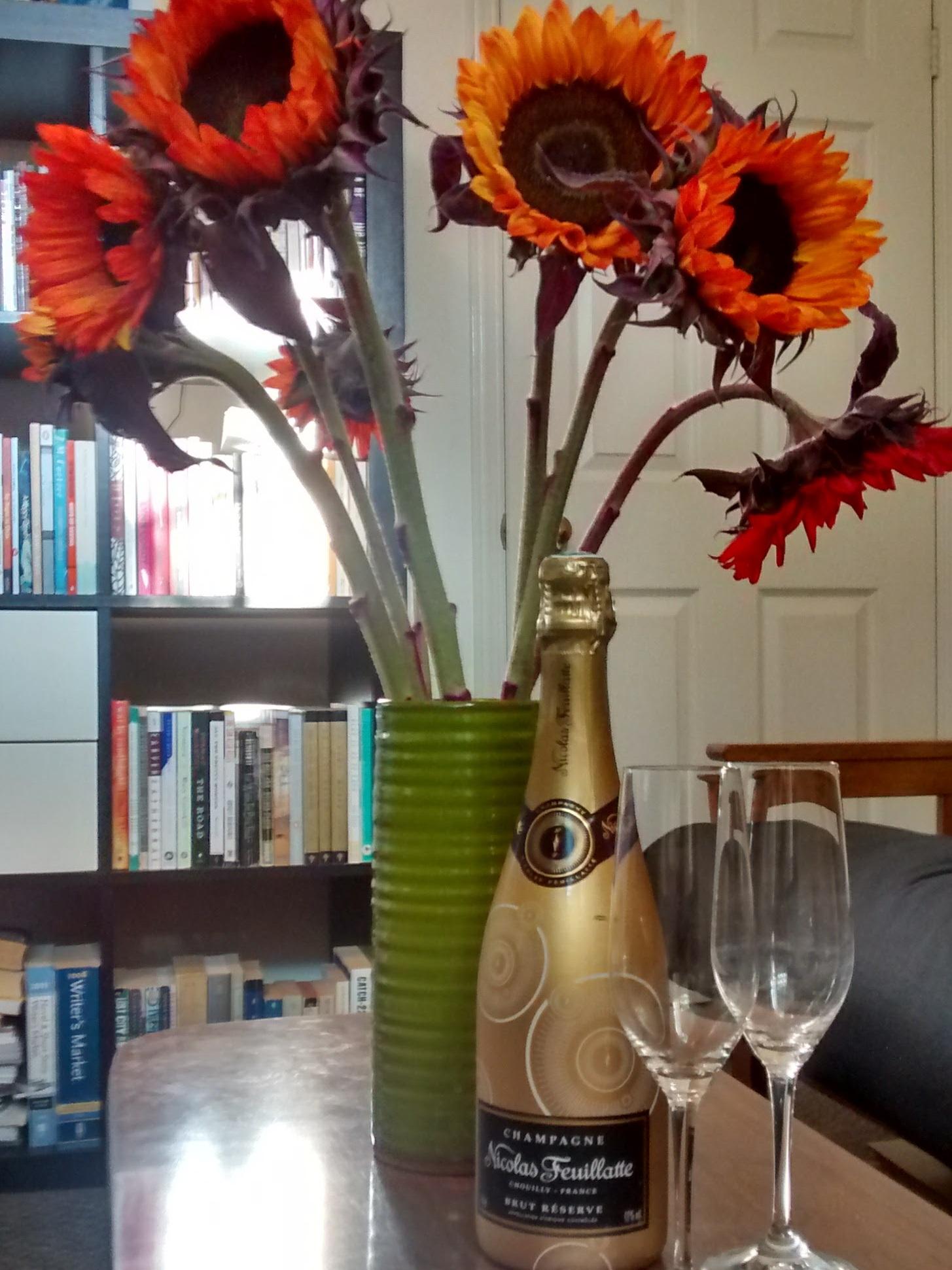 Celebrating beside my bookshelf!