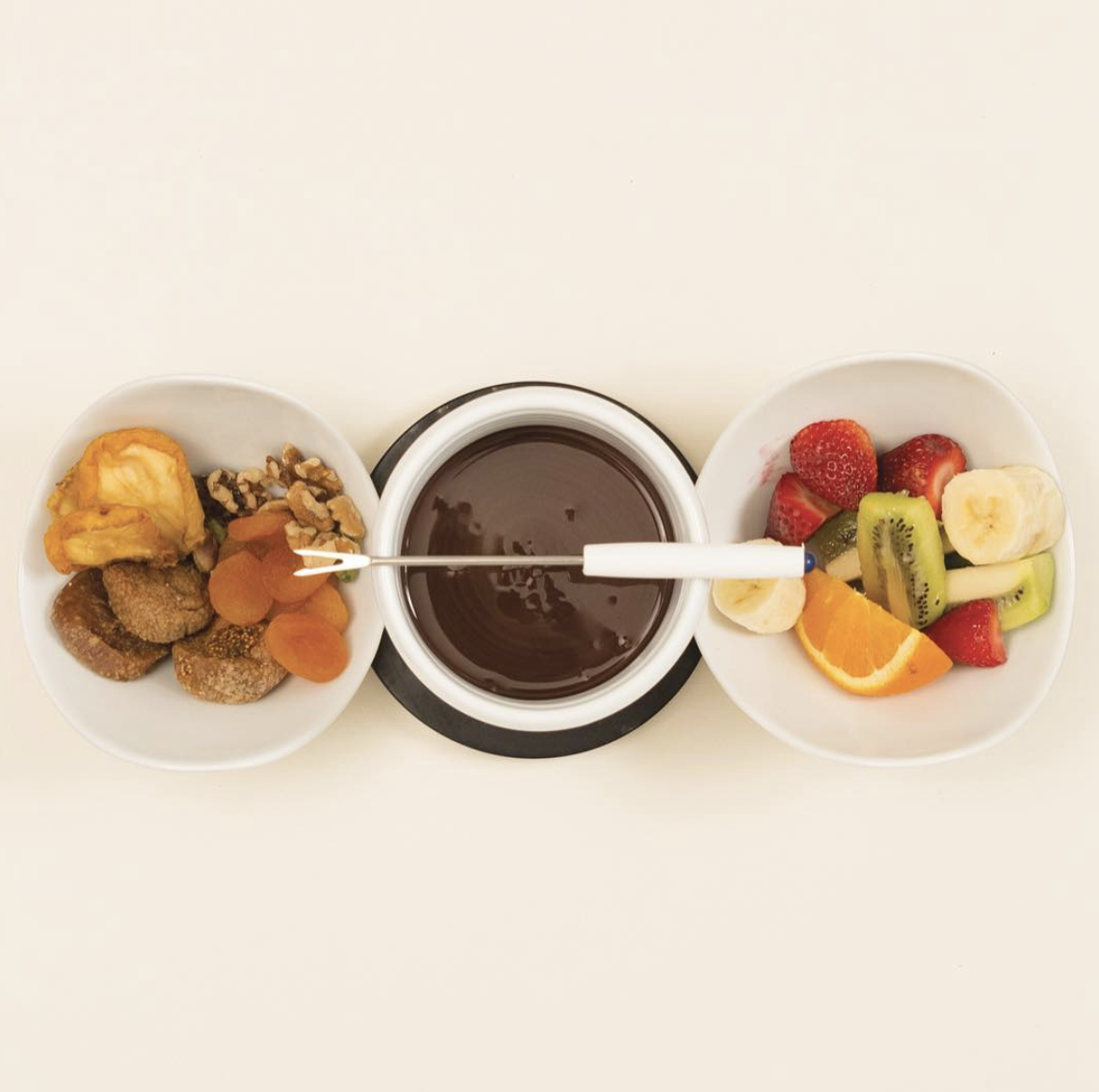 Patagonia Chocolate Fondue served with fruit and nuts - Patagonia Chocolates are chocolatiers, ice cream makers and coffee roasters with four cafes located in the Southern Lakes of New Zealand. There chocolate treats are award winning and not to be missed.