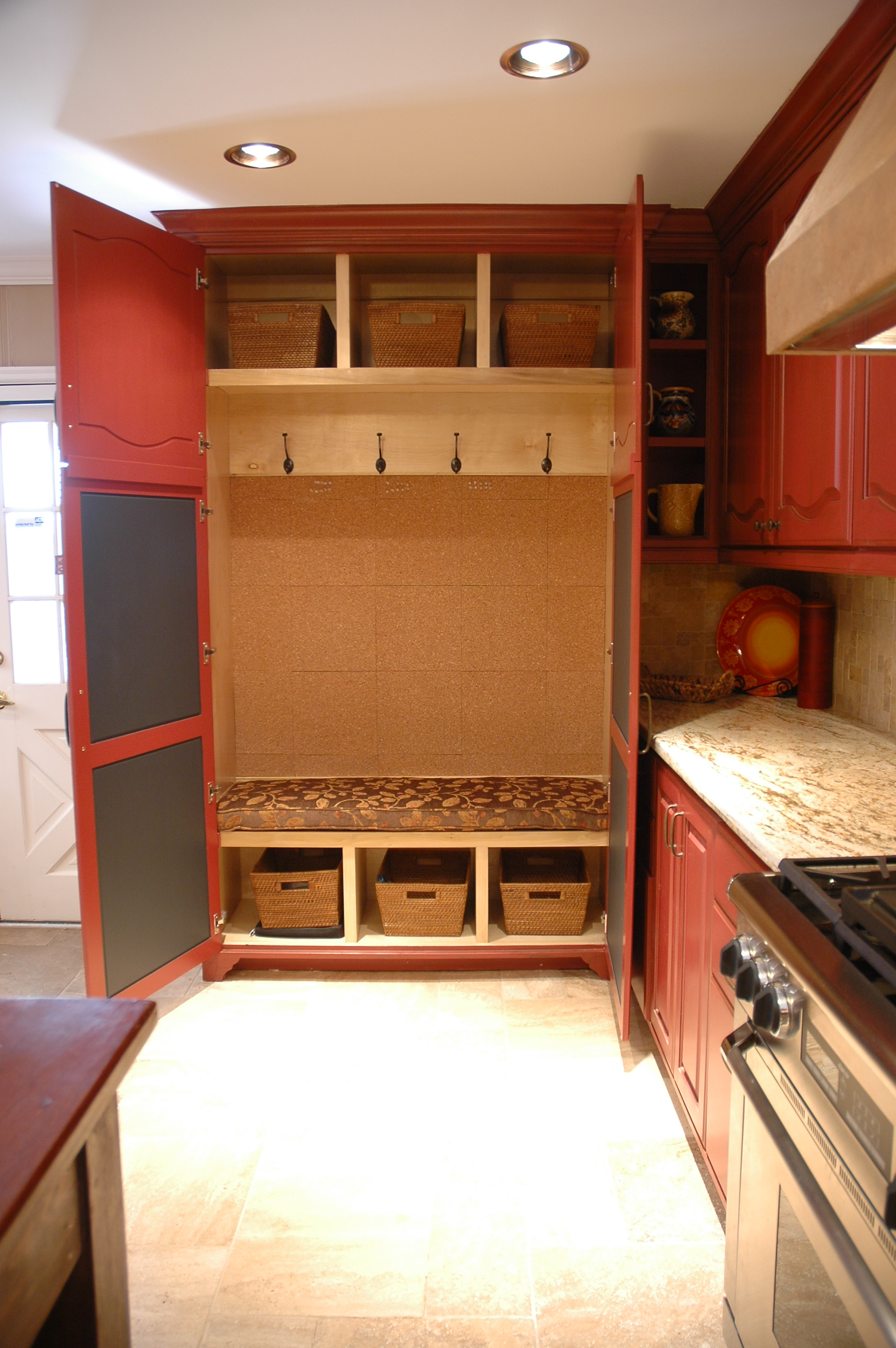 Fitted with a cushion, cork boad, baskets and chalkboad paint.JPG