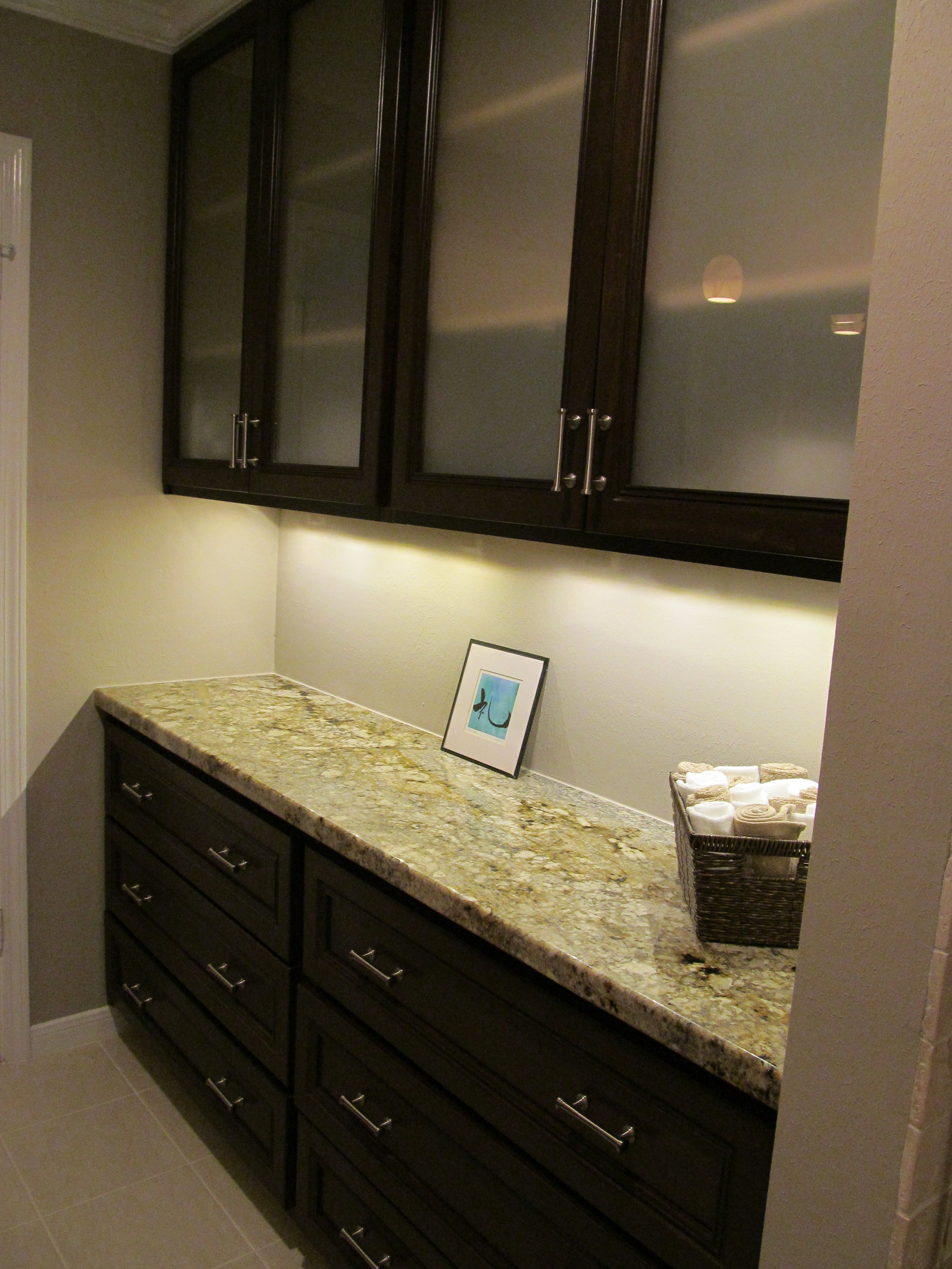 This bank of cabinetry was designed to address homeowners' needs.JPG
