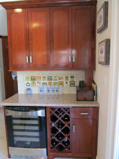 This bar area is on the back side of the kitchen.   Making the kitchen wall longer gave us the.JPG