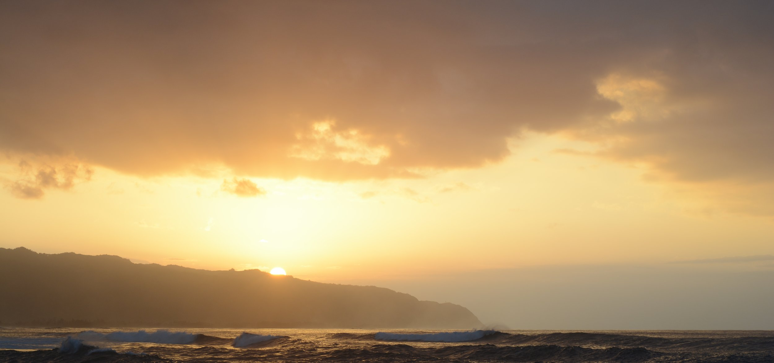 Sunset over Kaʻena point from Haleiwa, north shore Oahu