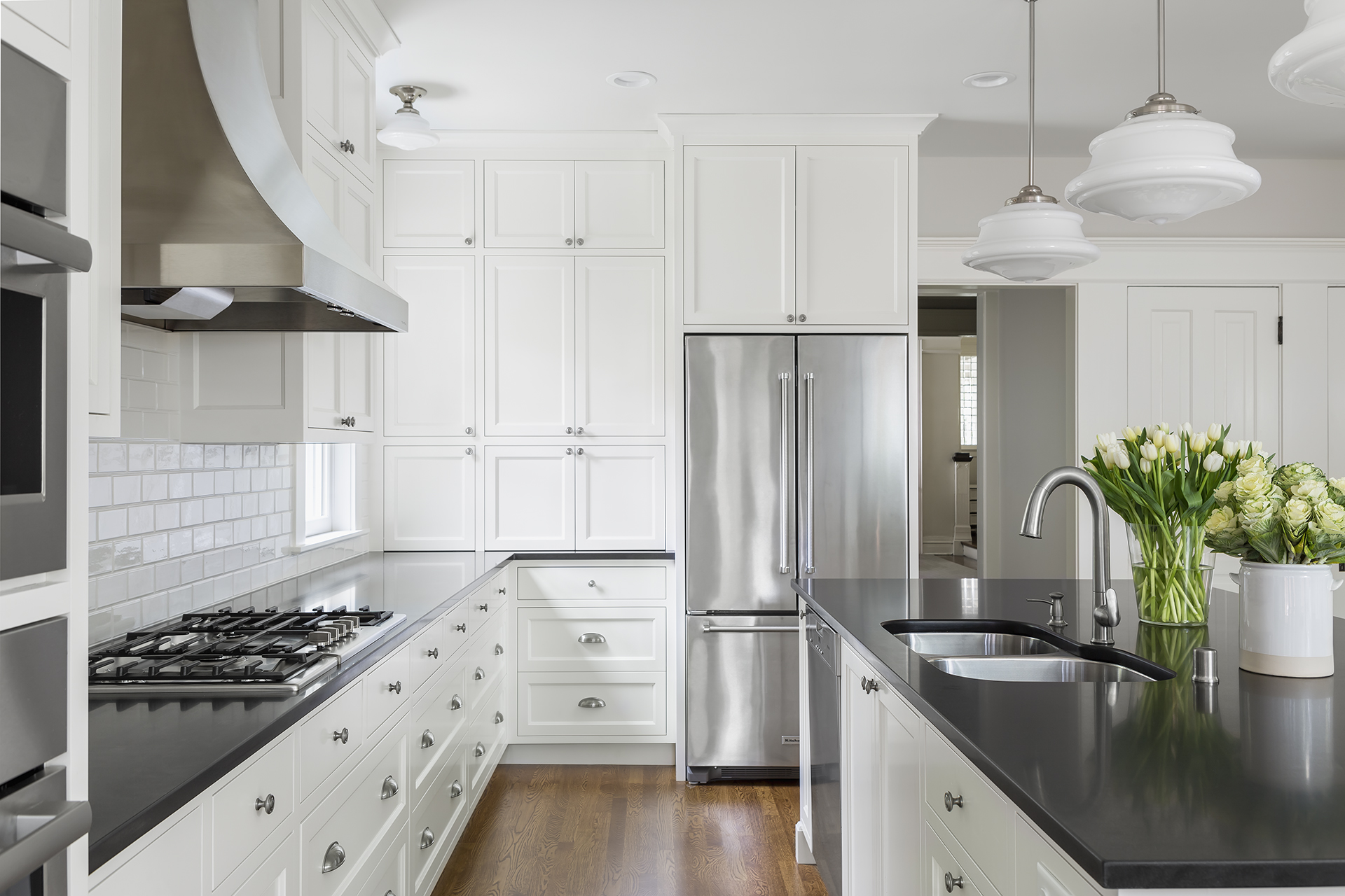 Ample storage was high on the homeowners wish list. This was achieved through a new layout with abundant cabinets and a generously sized island that comfortably accommodates all five family members.