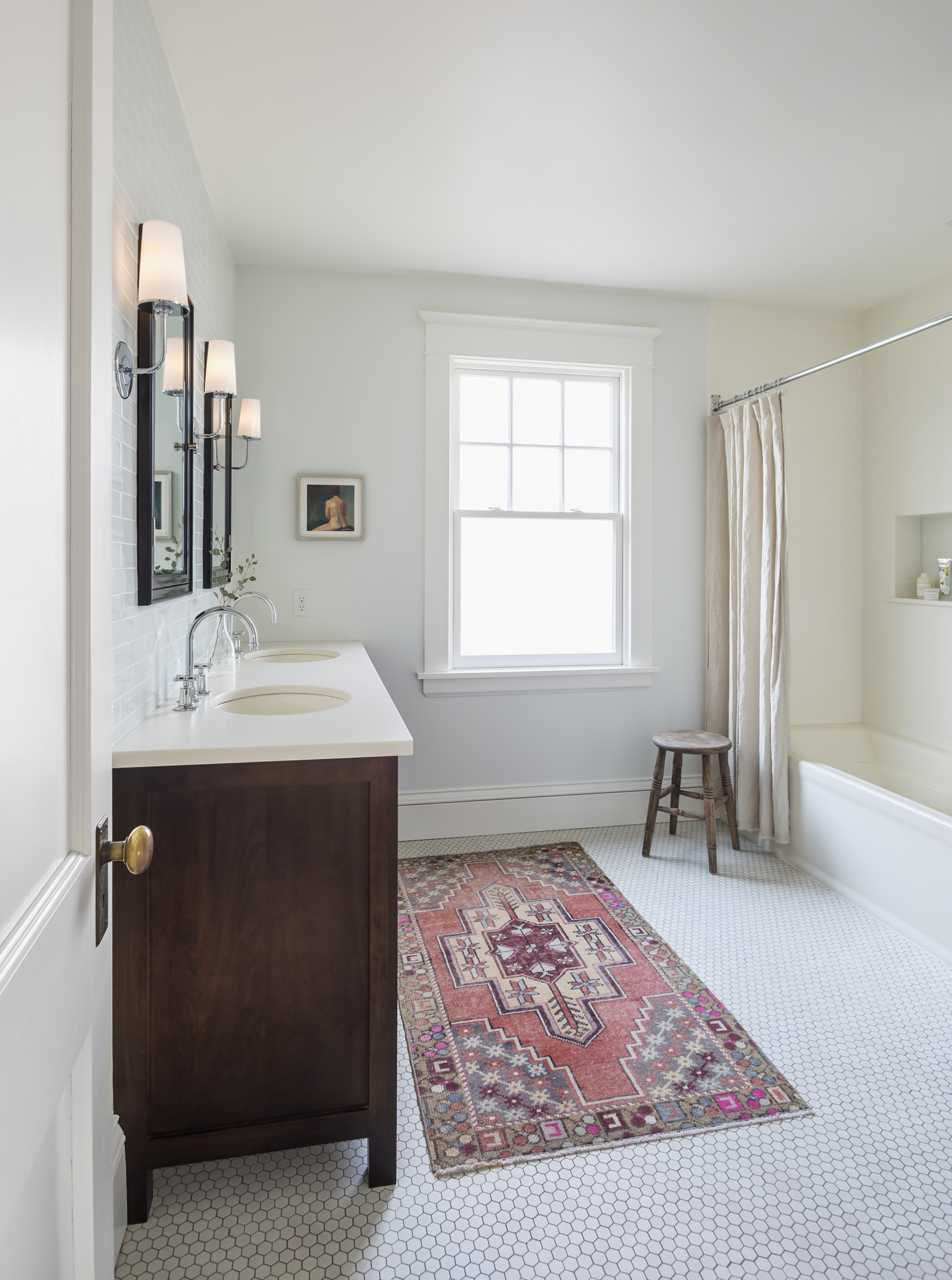 A classic and roomy bathroom took the place of what was once a small sewing or craft room.