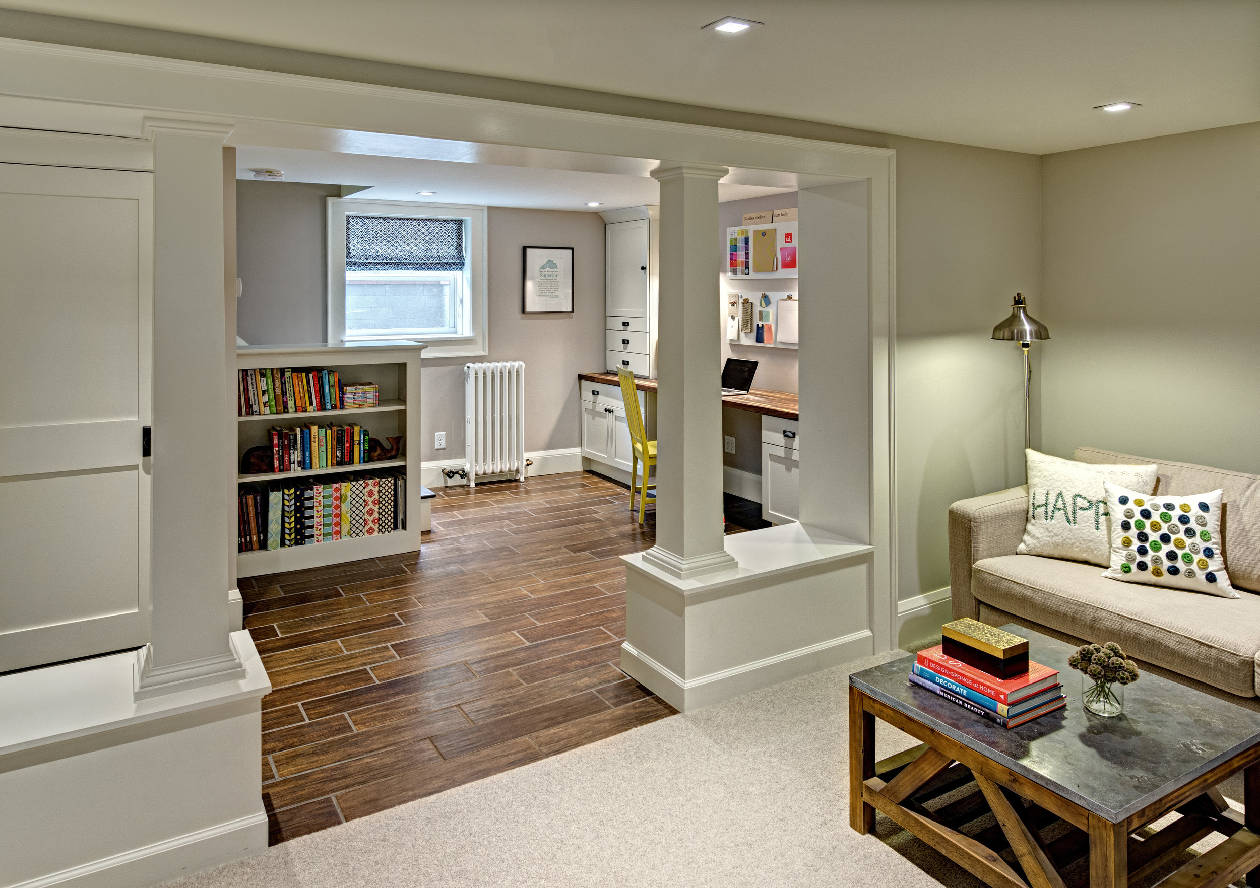 Integrated columns and a built-in bookcase help blend the new space with the older, original pieces of the home.