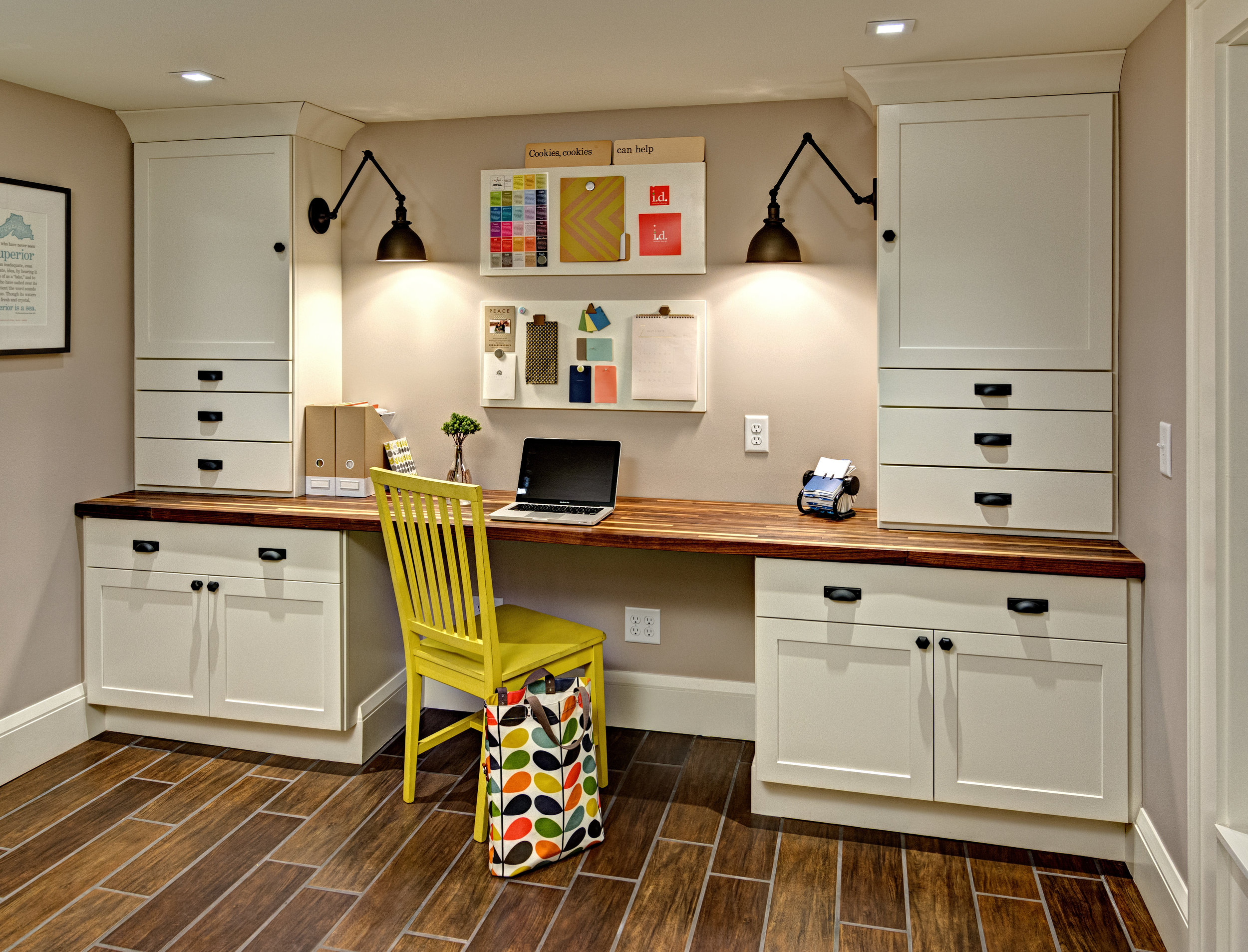 The homeowners wanted to make better use of their unfinished basement. Semi-custom cabinets and a walnut top create a small desk area in the space.