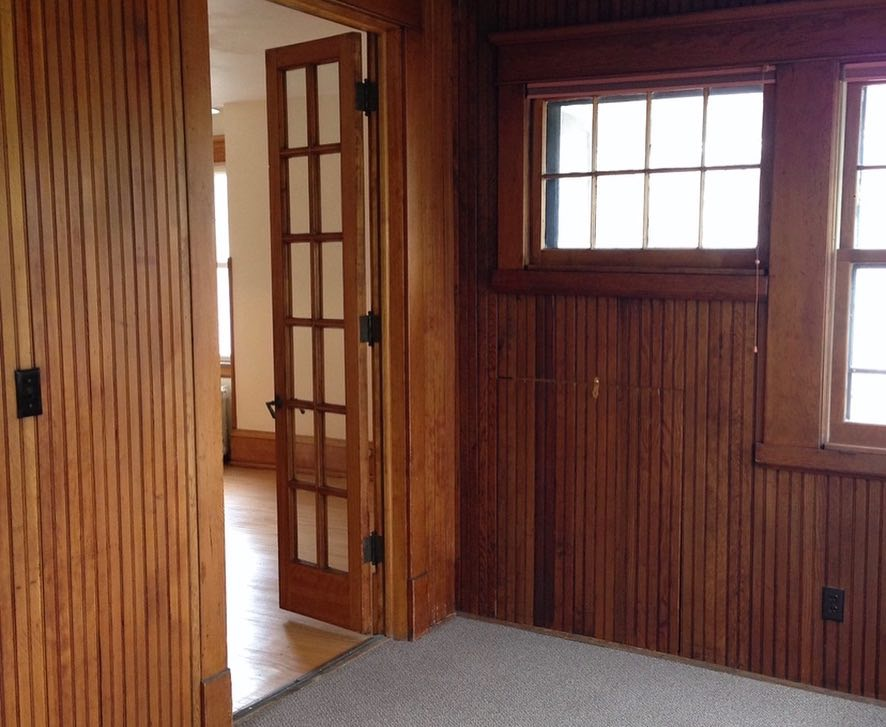 Prior to the renovation, the walls were lined with beadboard and the floor was carpeted.