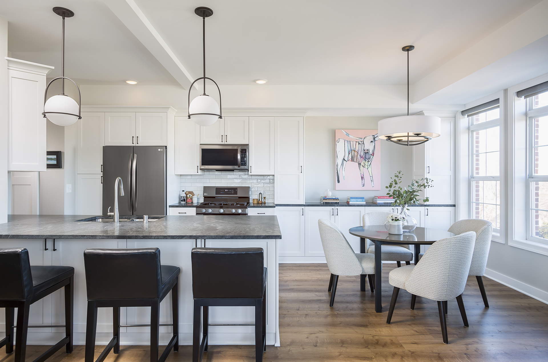 Tons of natural light paired with bright white cabinetry make this smaller kitchen feel airy and spacious.