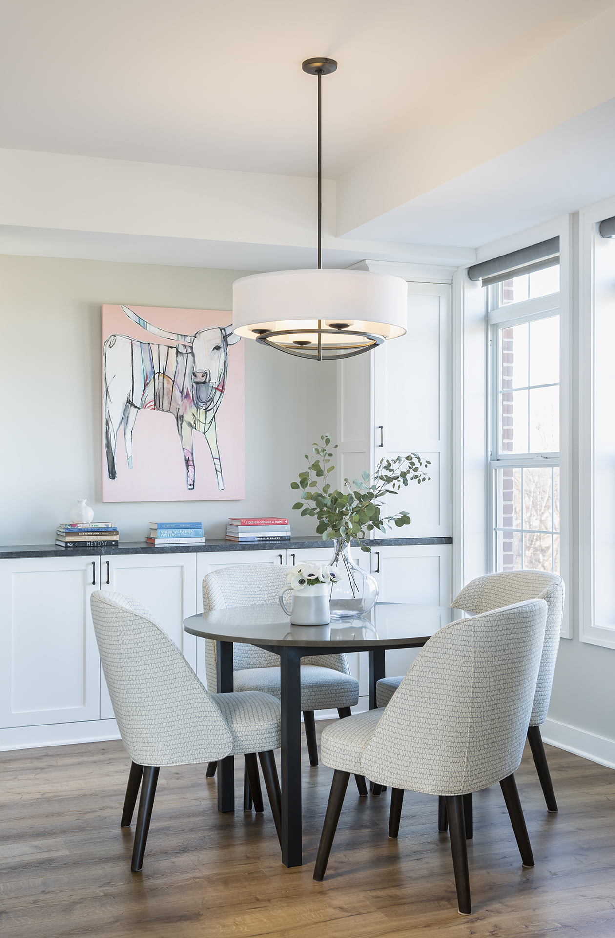 The custom cabinetry continues into the dining room and creates a seamless look that makes the entire space feel larger.