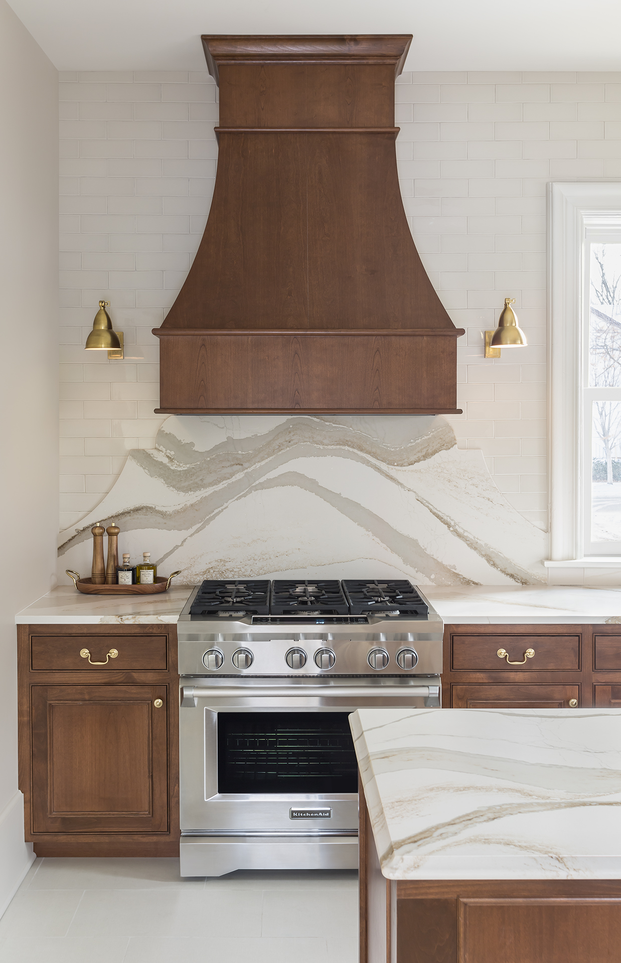 Traditional details such as inset doors with a beaded frame blend with more contemporary elements to create a kitchen that feels classic, unique, and unexpected all at the same time.